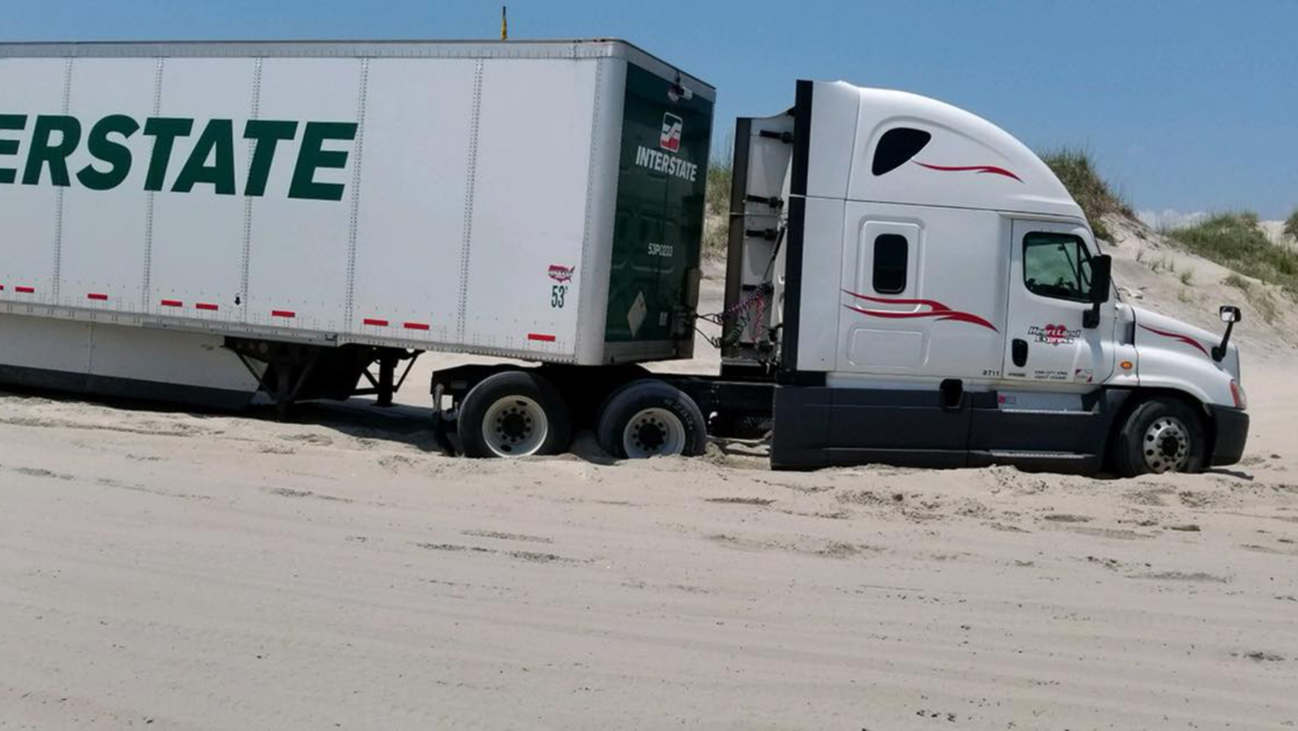A truck driver followed his GPS the wrong way and ended up stranded on a North Carolina beach for hours.