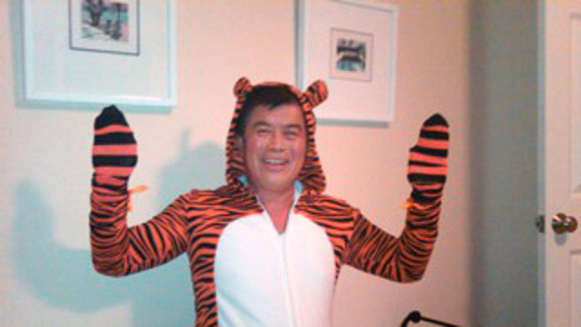 """FILE - In this image provided by the Willamette Week newspaper, and taken Oct. 2, 2010 in Portland, Ore, U.S. Rep. David Wu is seen in a tiger costume. The Oregon congressman says that he accepted prescription drugs from a campaign contributor last October, around the time when members of his staff complained of his erratic behavior. Wu said the photos were taken while he was """"joshing around"""" with his children in October just before Halloween. (AP Photo/Willamette Week)"""