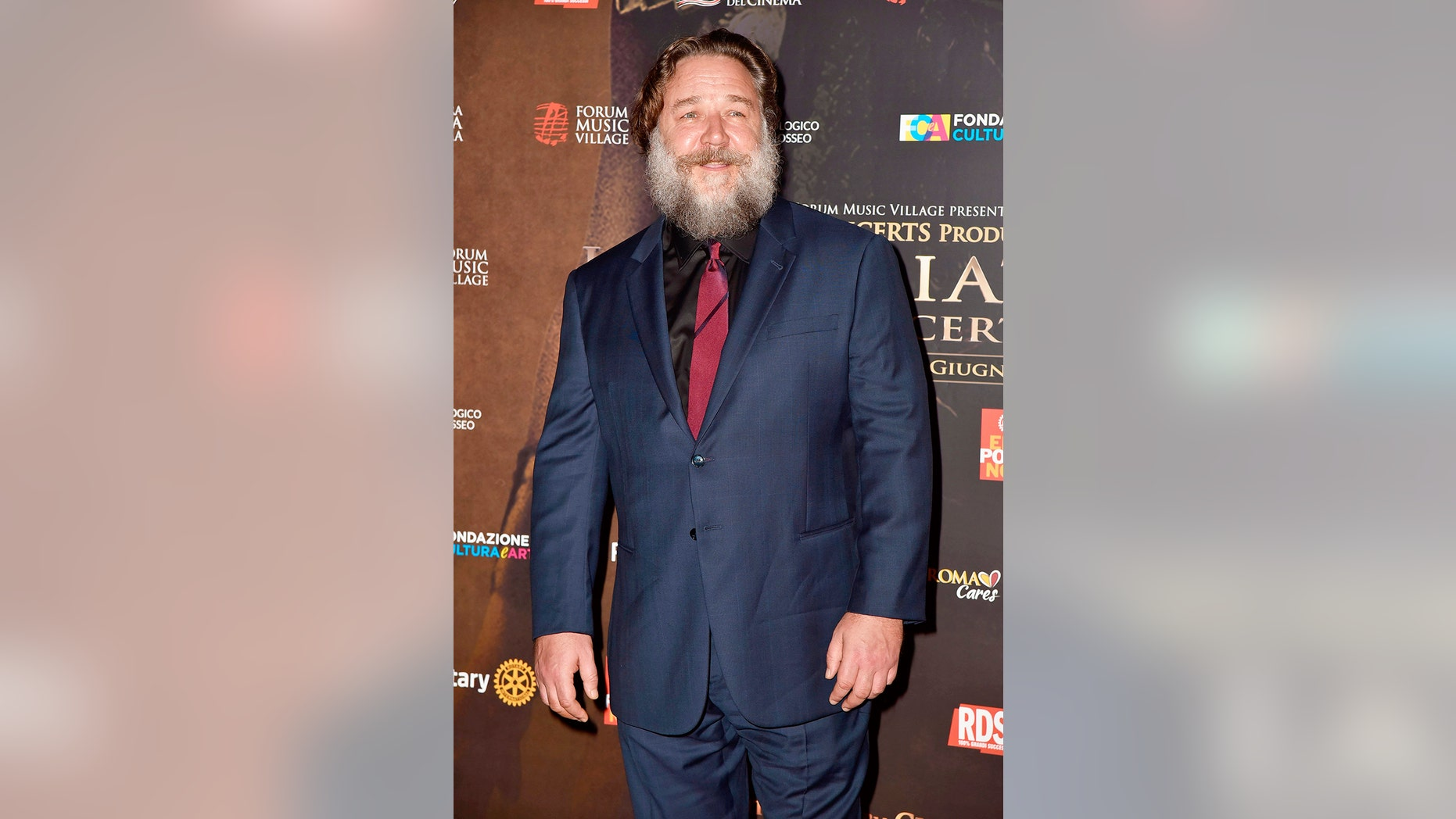 "Russell Crowe displays his portly frame and bushy beard as he attends the ""Gladiator in Concert"" event with Connie Nielsen and Francesco Totti. June 6, 2018"