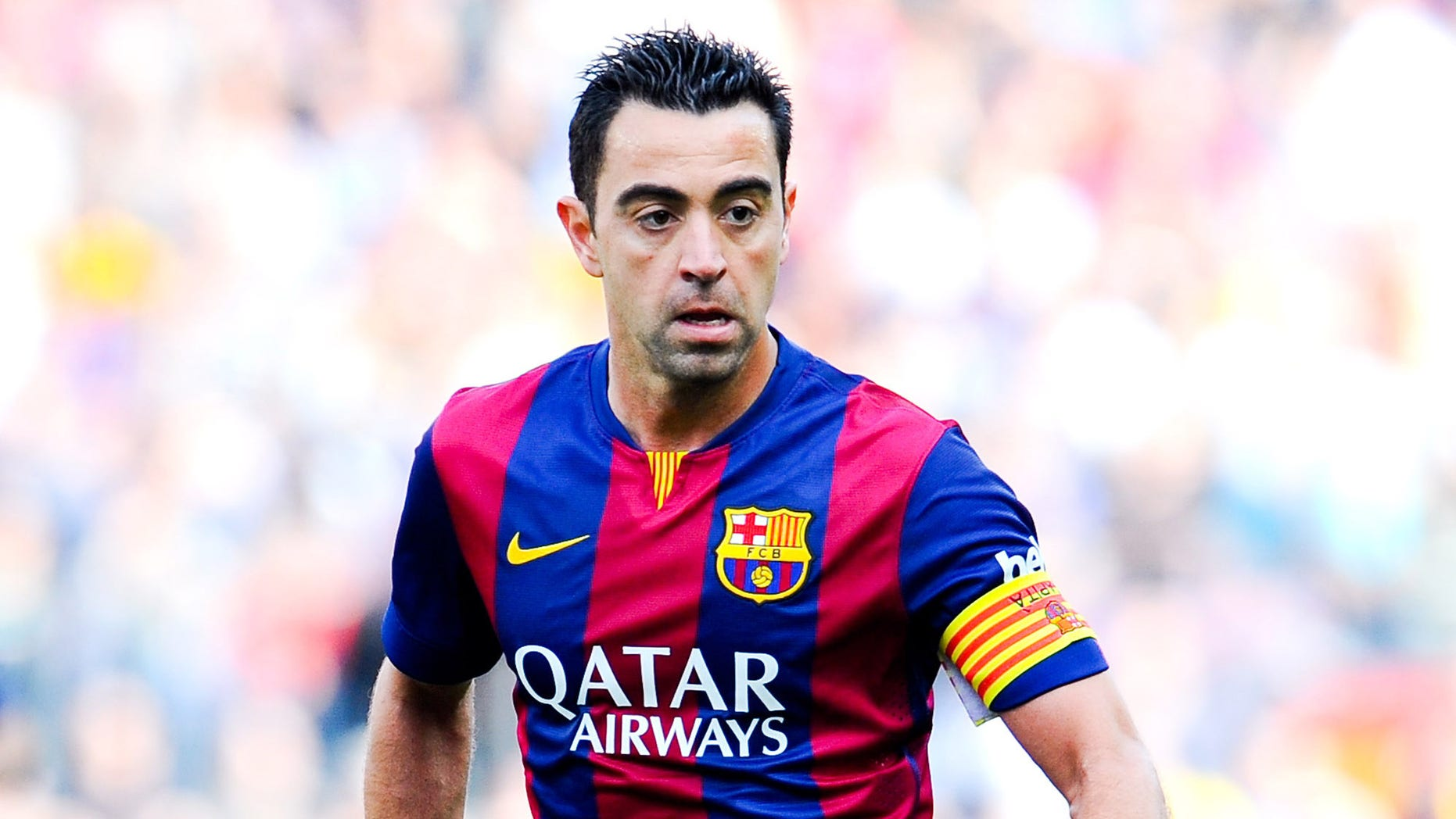 BARCELONA, SPAIN - APRIL 18:  Xavi Hernandez of FC Barcelona runs with the ball during the La Liga match between FC Barcelona and Valencia CF at Camp Nou on April 18, 2015 in Barcelona, Spain.  (Photo by David Ramos/Getty Images)