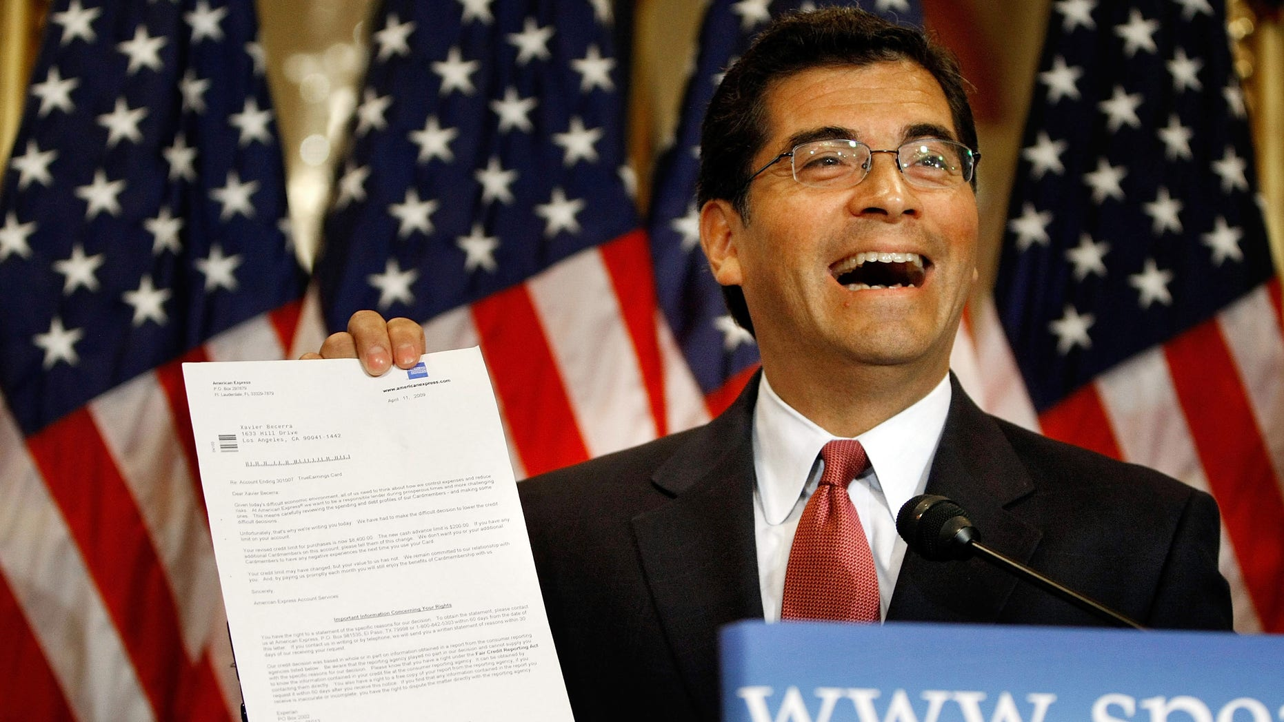 WASHINGTON - MAY 22:  House Democratic Caucus Vice Chair Rep. Xavier Becerra (D-CA) holds up a letter he received from his credit card company informing hime that his interest rate will increace during the Speaker of the House's weekly news conference at the U.S. Captiol May 22, 2009 in Washington, DC. Speaker of the Hosue Nancy Pelosi (D-CA) turned the news conference into an opportunity to list what she and the Democratic House leadership considered their successes of the 111th Congress' first session. She took a handful of questions about her upcomming trip to China and her statements about the CIA.  (Photo by Chip Somodevilla/Getty Images)