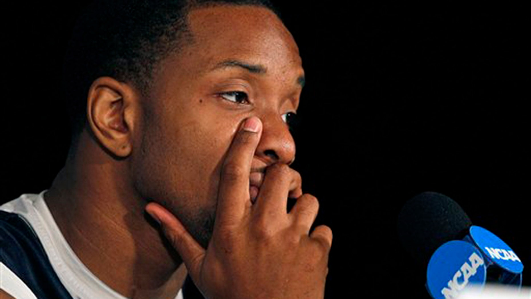March 17, 2012: Xavier's Dezmine Wells ponders a question during a news conference in Greensboro, N.C.