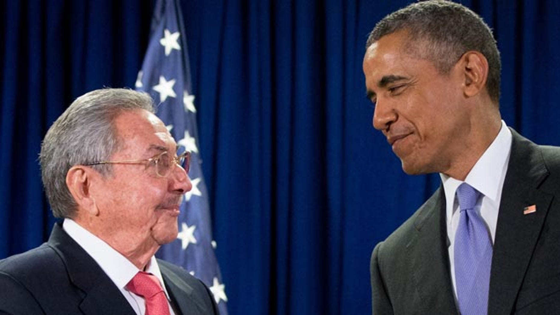 FILE - In this Tuesday, Sept. 29, 2015 file photo, U.S. President Barack Obama stands with Cuba's President Raul Castro before a bilateral meeting at the United Nations headquarters. (AP Photo/Andrew Harnik)