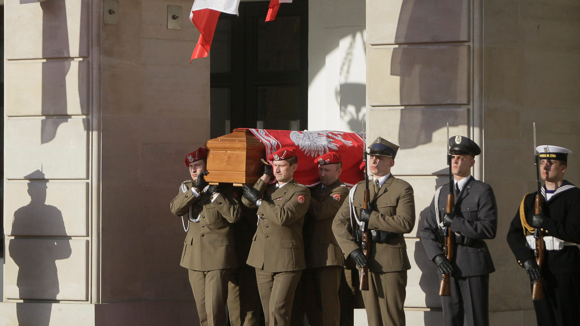 April 17: Honor guards carry the coffin of late Polish President Lech Kaczynski in front of the President's Palace in Warsaw, Poland. President Lech Kaczynski was killed in a plane crash.