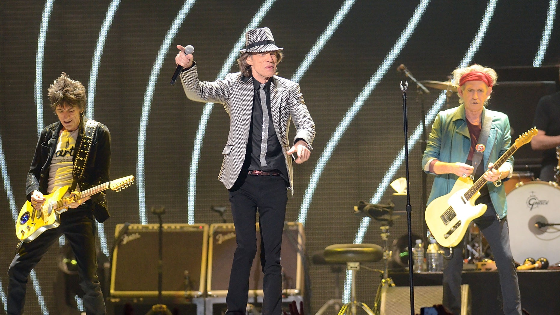 Dec. 15, 2012: In this file photo, singer Mick Jagger, center, guitarists Ronnie Wood, left, and Keith Richards, of The Rolling Stones perform live at the Prudential Center in Newark, N.J.