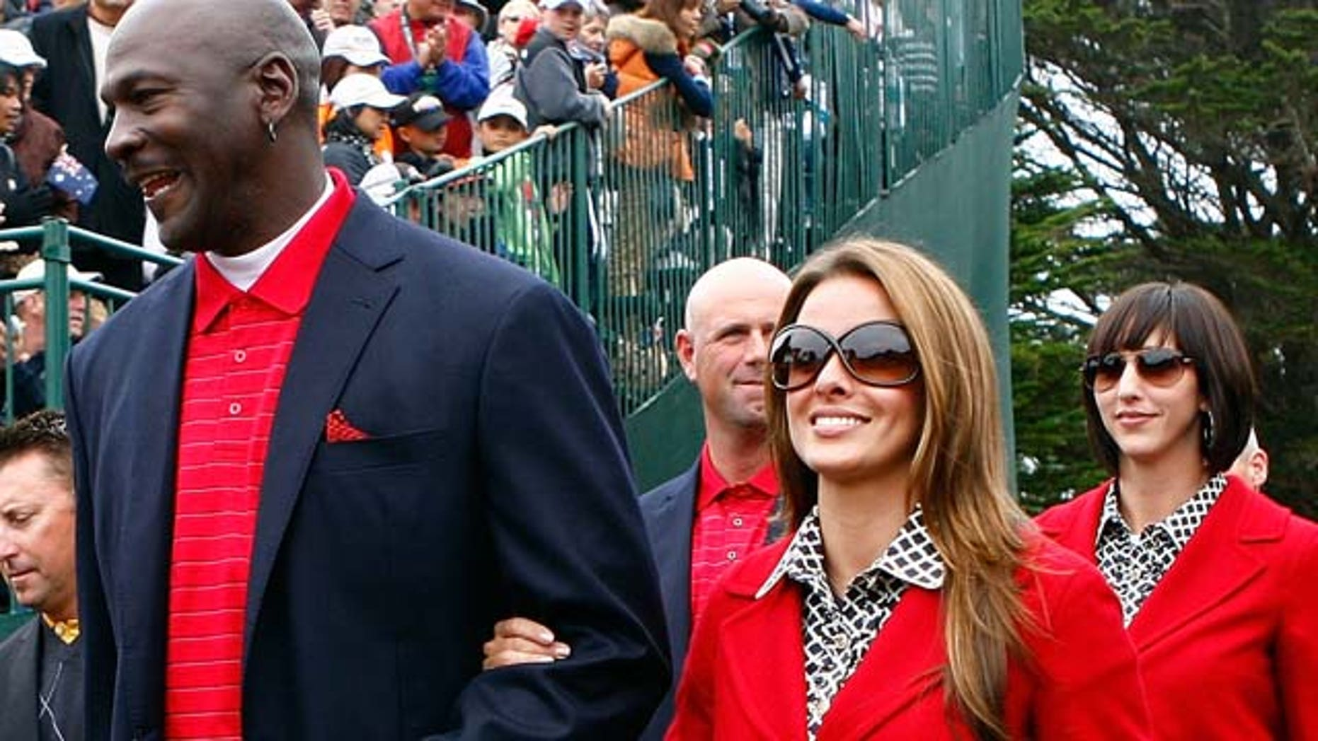 Oct.11, 2009:  Michael Jordan of the USA Team walks with his girlfriend Yvette Prieto to the closing ceremonies during the Final Round Singles Matches of The Presidents Cup at Harding Park Golf Course in San Francisco, Calif.
