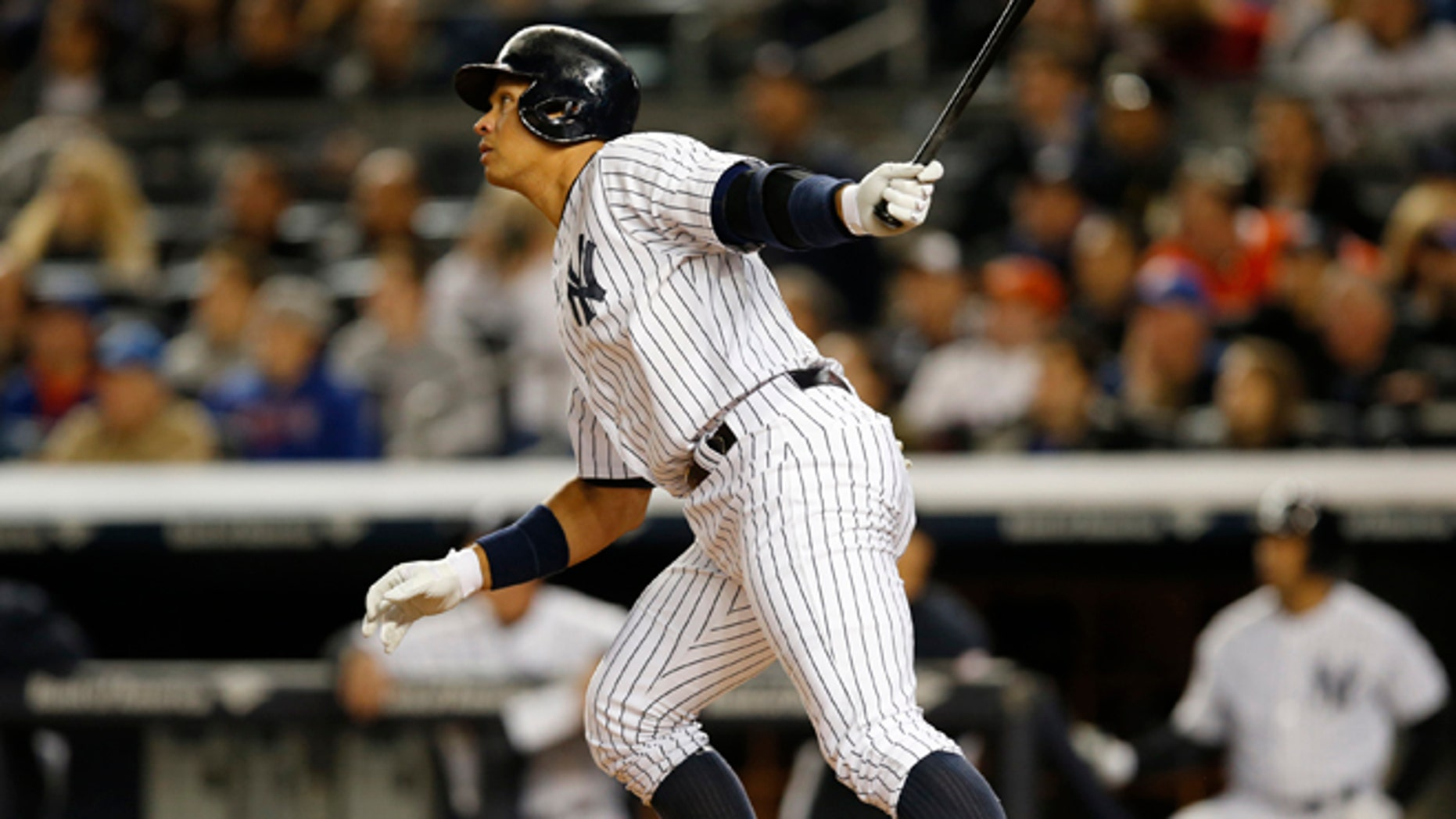 New York Yankees designated hitter Alex Rodriguez (13) hits a first-inning solo home run in a baseball game against the New York Mets at Yankee Stadium in New York, Sunday, April 26, 2015. Rodriguez now stands at 659 career home runs and needs one more to tie Willie Mays.  (AP Photo/Kathy Willens)