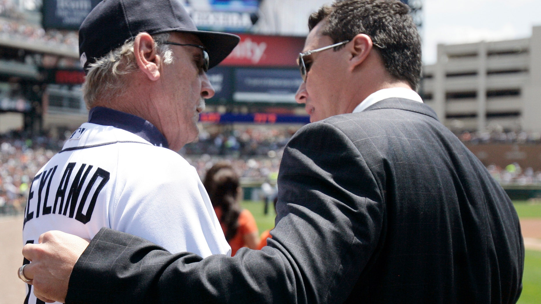 Former Detroit Tiger Magglio Ordonez, right, talks with Tigers manager Jim Leyland, left, following his retirement ceremony before a baseball game against the New York Yankees, Sunday, June 3, 2012, in Detroit. Ordonez has made his retirement official, ending a stellar career in which the outfielder hit .309 in 15 seasons with the Detroit Tigers and Chicago White Sox. (AP Photo/Duane Burleson)