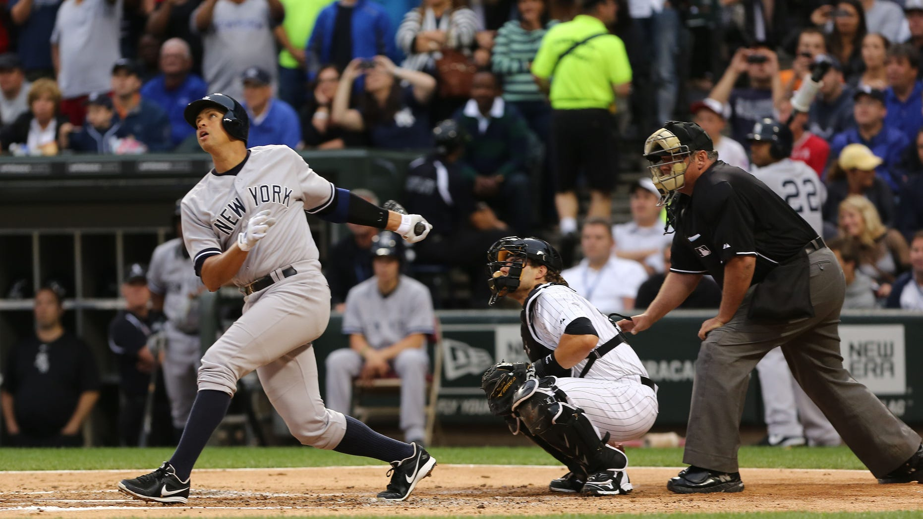New York Yankees' Alex Rodriguez, left, gets a hit in his first at bat against the Chicago White Sox in the first inning in a baseball game at US Cellular Field, Monday, Aug. 5, 2013,  in Chicago. He was suspended through 2014 when Major League Baseball disciplined 13 players in a drug case, the most sweeping punishment since the Black Sox scandal nearly a century ago. (AP Photo/Charles Cherney)
