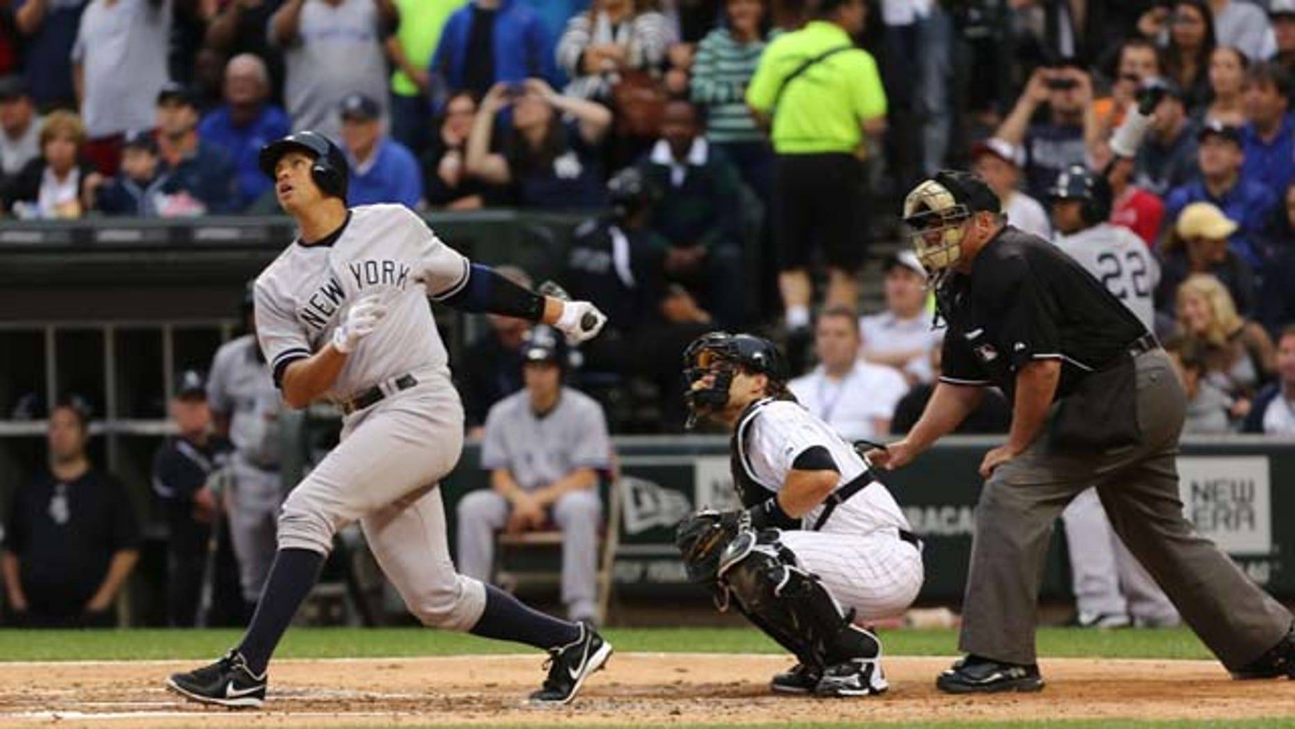 August 5, 2013: New York Yankees' Alex Rodriguez, left, gets a hit in his first at bat against the Chicago White Sox in the first inning in a baseball game at US Cellular Field in Chicago.