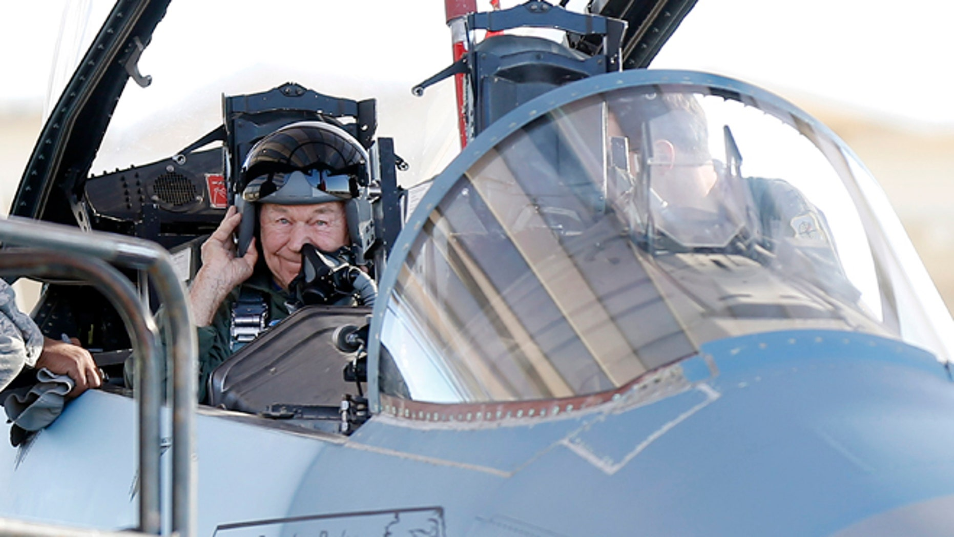 Oct. 14: Retired Air Force Brig. Gen. Charles Yeager straps into an F-15D for a re-enactment flight commemorating his breaking of the sound barrier 65 years ago at Nellis Air Force Base, Nev.