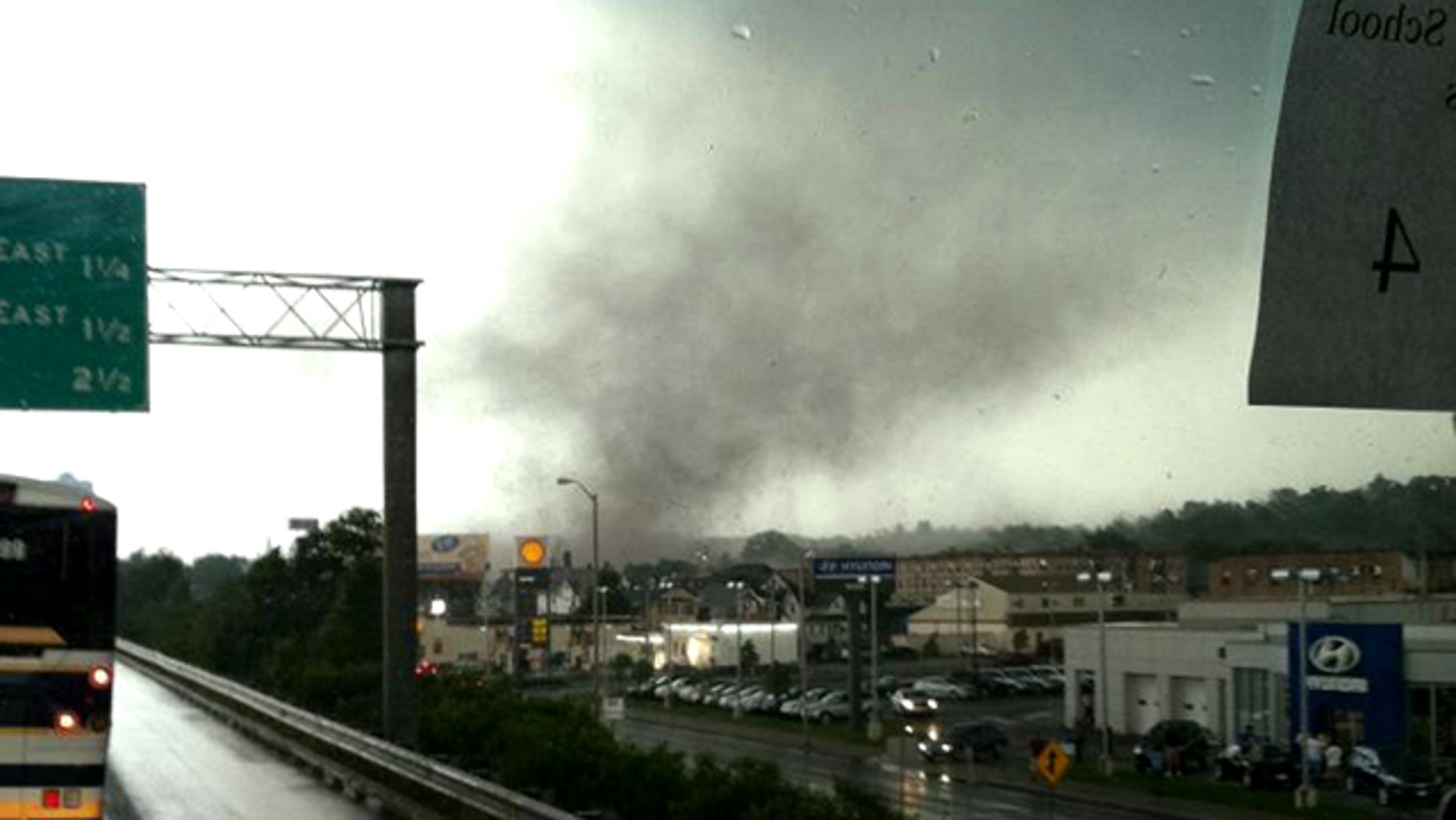 June 1, 2011: Traveling in a bus on Interstate Route 91, in Springfield, Mass., Michelle Gilbert photographed a funnel cloud that touched the ground in Springfield, Mass. causing widespread damage -- and the state's first tornado-related deaths in 16 years.