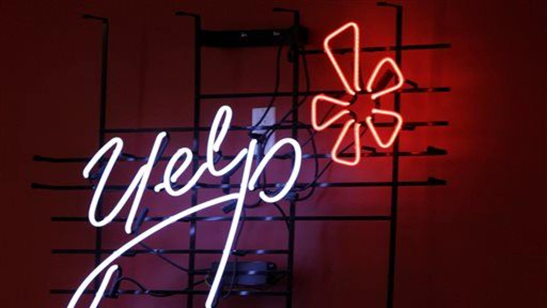 The logo of the online reviews website Yelp on a wall at the company's offices in New York.