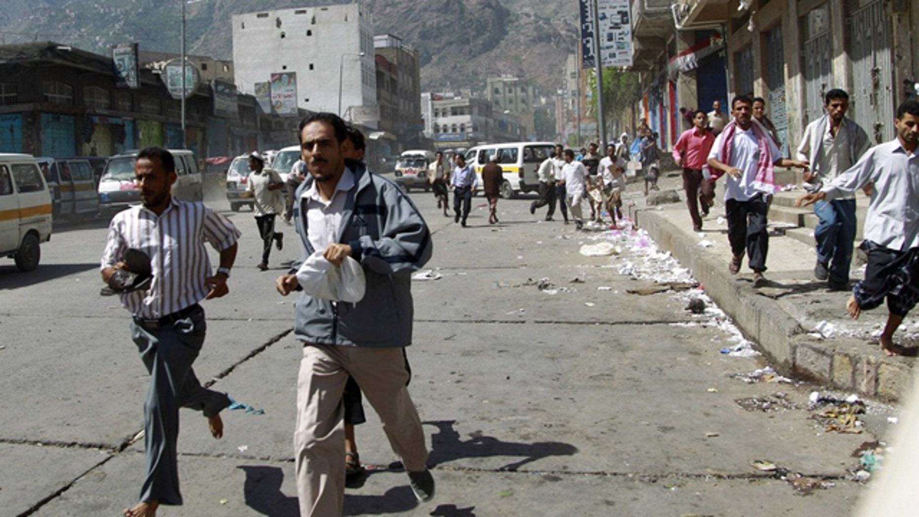 May 31: Government protesters run after soldiers opened fire to disperse them as they began gathering for a demonstration to demand the ouster of Yemen's President Ali Abdullah Saleh in the southern city of Taiz.