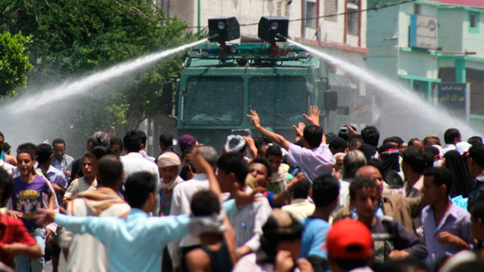 Sept. 20: Yemeni riot police use water cannons to disperse anti-government protestors during clashes, in Taiz, Yemen.