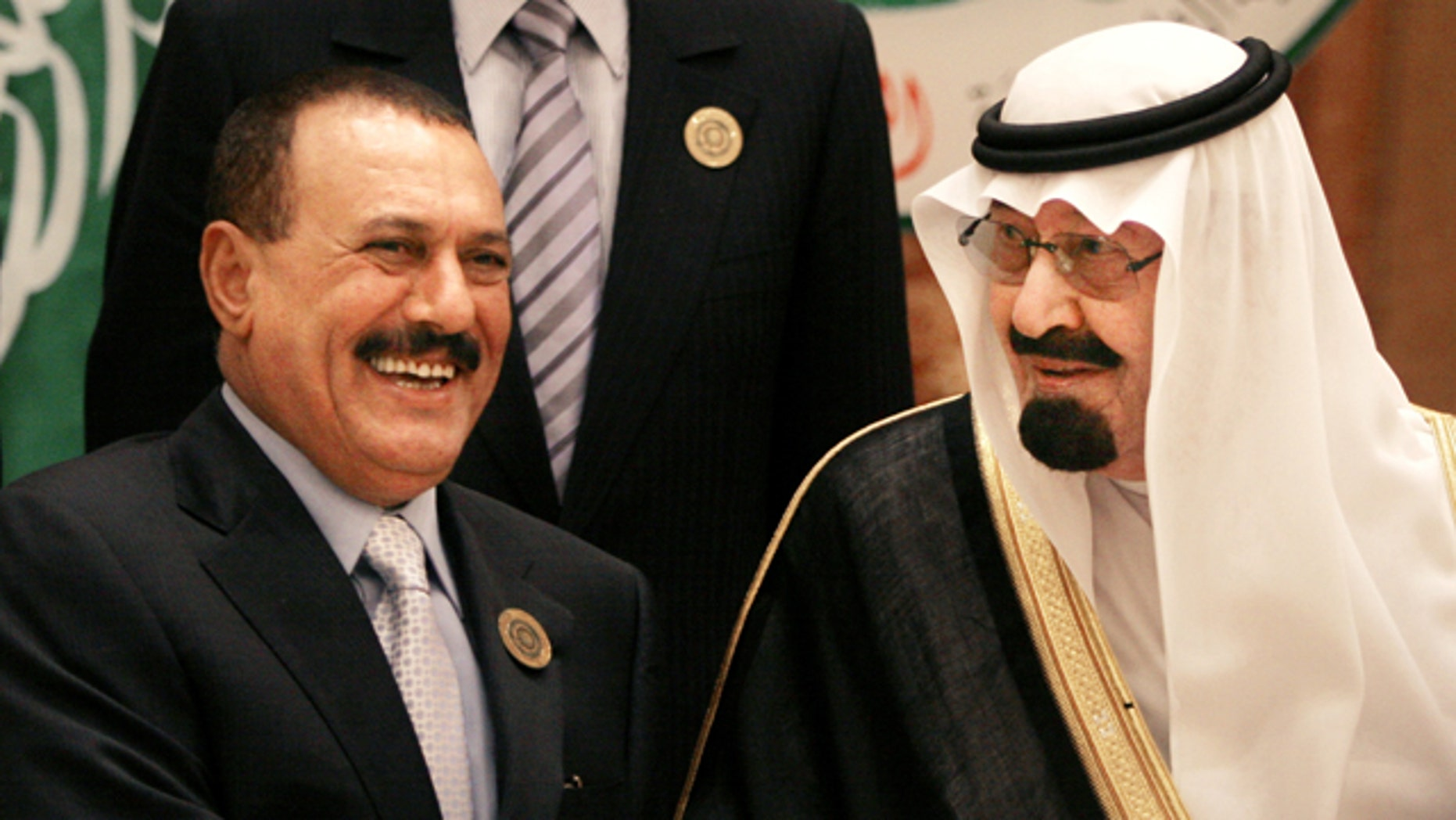 FILE - In this March 27, 2007 file photo, Saudi King Abdullah bin Abd al-Aziz, right, shakes hands with Yemeni President Ali Abdullah Saleh before the Arab summit in Riyadh, Saudi Arabia. King Abdullah has mediated a one-week cease-fire in Yemen between the warring forces of President Ali Abdullah Saleh and the anti-government opposition, following an attack on Saleh's presidential palace compound in Sanaa, Yemen, Friday, June 3, 2011.