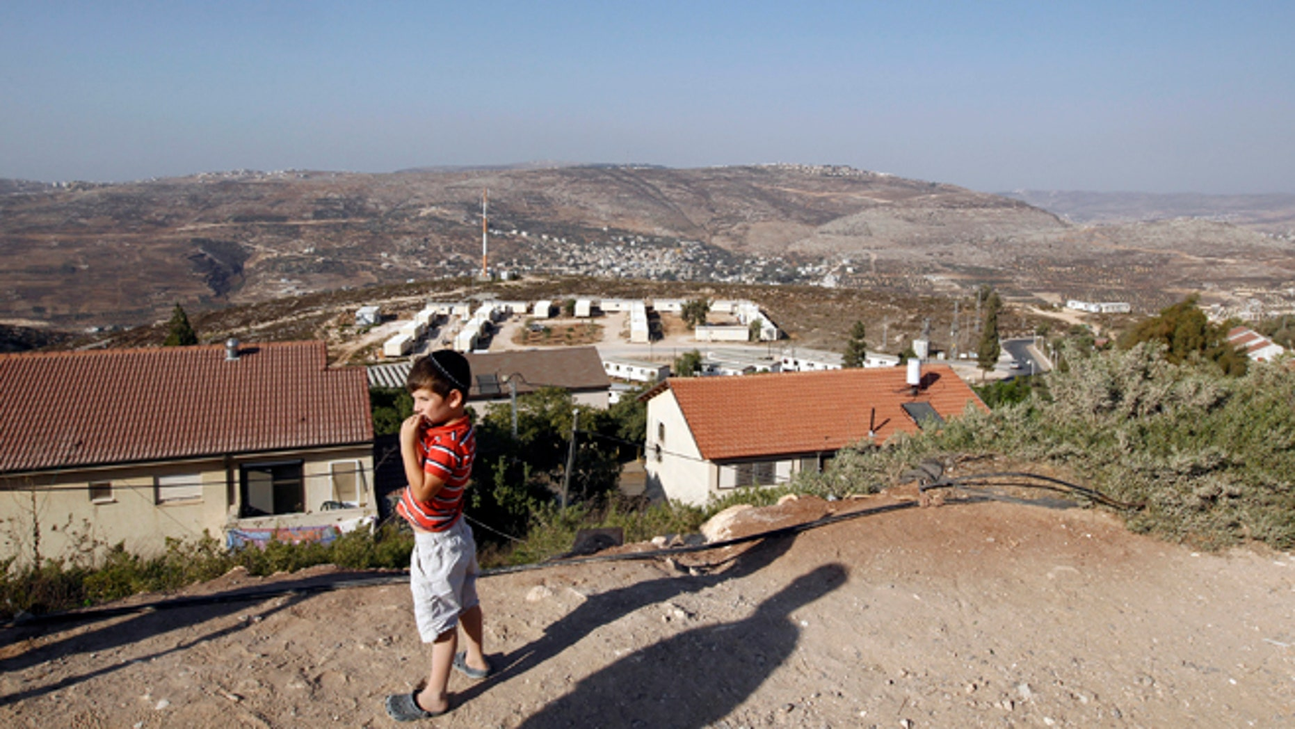 Sept. 20, 2010: A boy stands in the West Bank Jewish settlement of Yitzhar, south of Nablus.