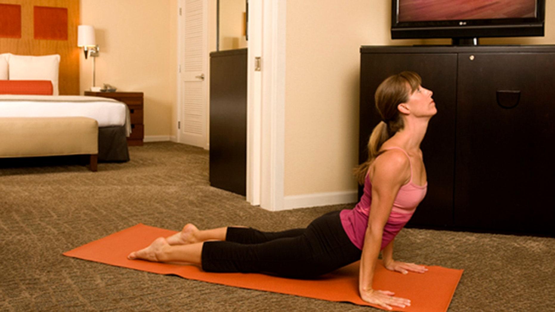 A woman practices yoga in Kimpton's Hotel Palomar in San Francisco, California.
