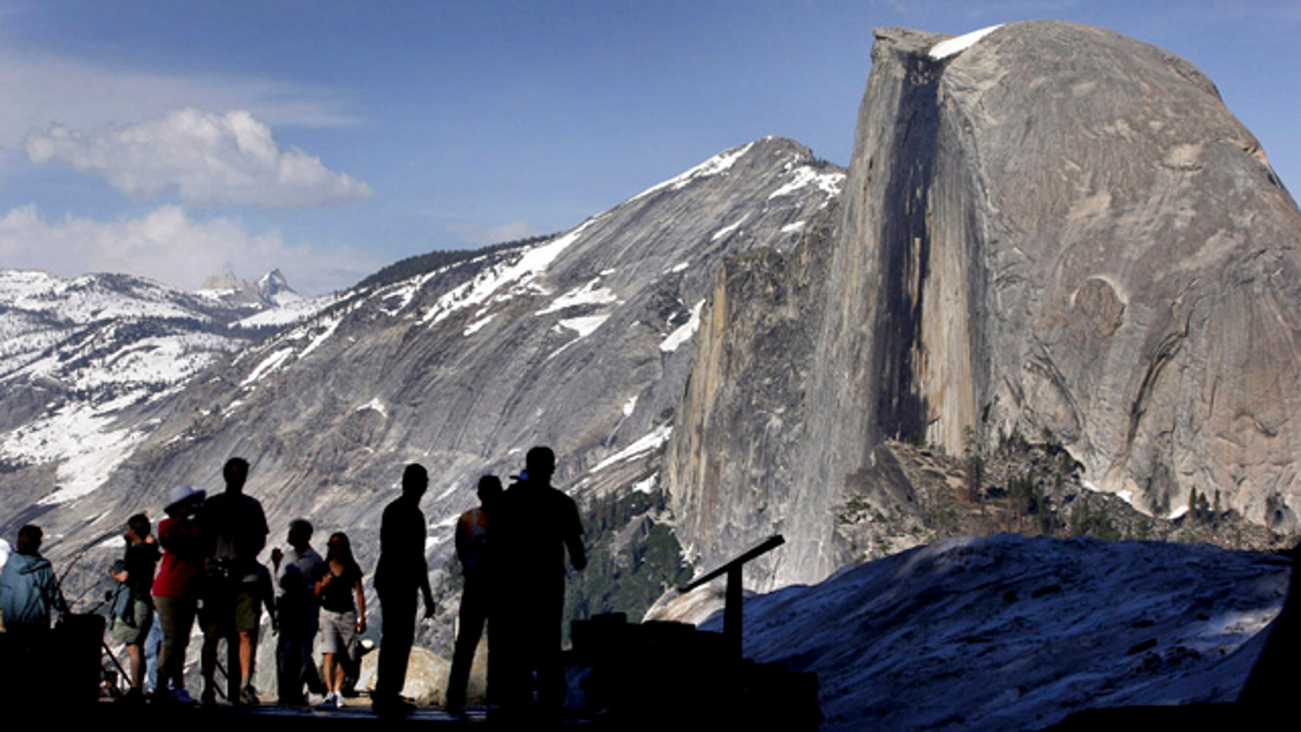 FILE - In this 2005 file photo, visitors view Half Dome from Glacier Point at Yosemite National Park, Calif. (AP Photo/Dino Vournas, File)