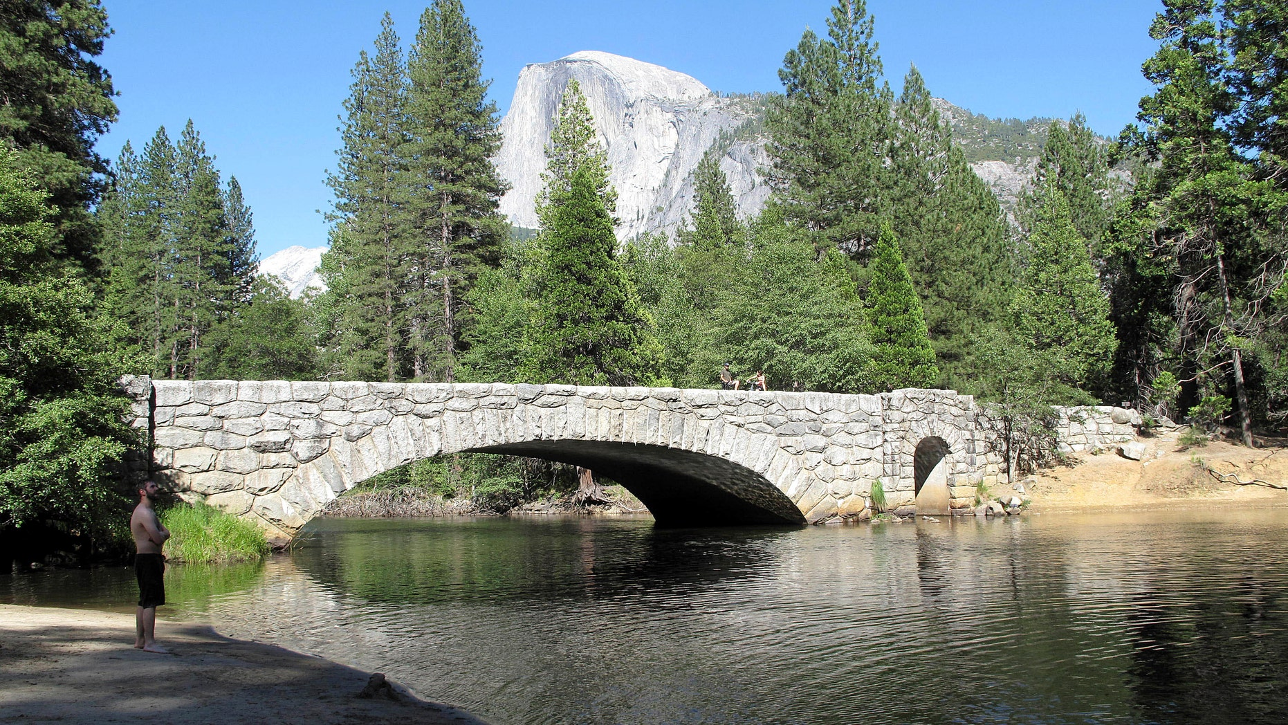 June 12, 2012: This photo shows Yosemite National Park's Stoneman Bridge, a single, arching span faced with rough-hewn granite, provides a dramatic foreground to Half Dome, the park's most iconic feature.