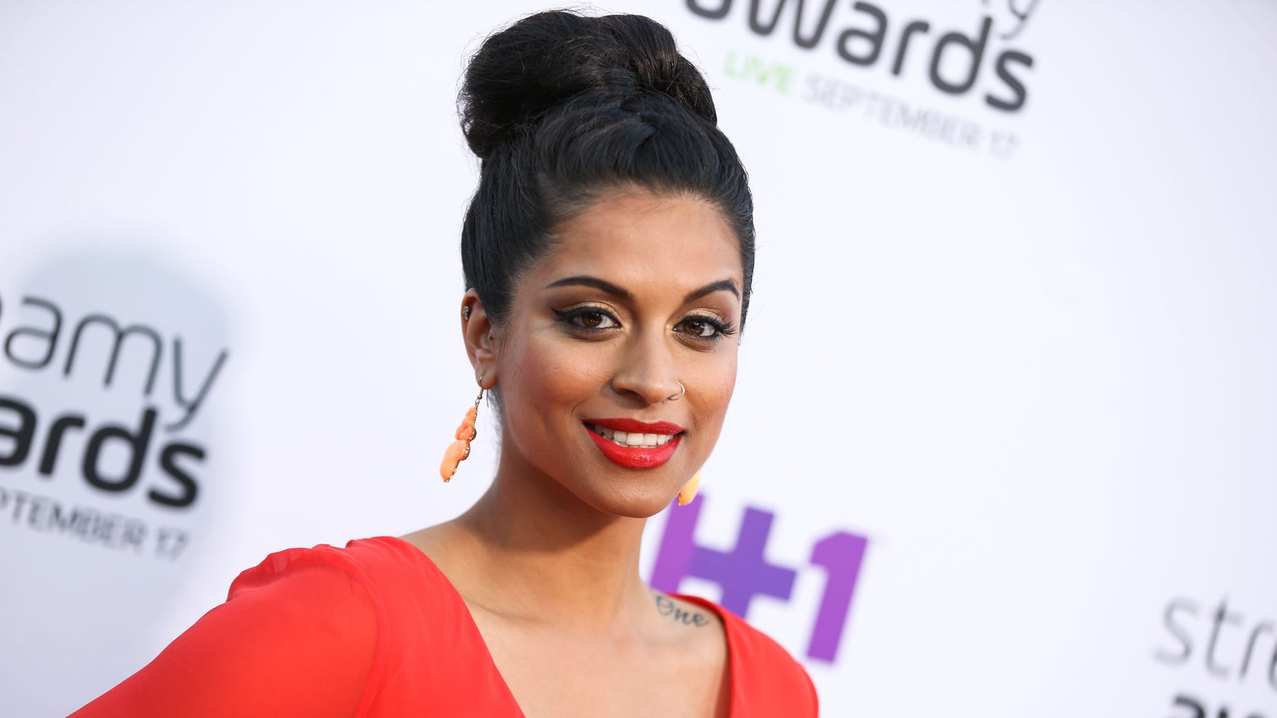 """FILE - In this Sept. 17, 2015 file photo, Lilly Singh arrives at the 5th Annual Streamy Awards at the Hollywood Palladium in Los Angeles. """"Lazer Team"""" was the most funded original film in Indiegogos history, and it's been selling out hundreds of theaters for fan screenings since Jan. 27, 2016. In addition to """"Lazer Team,"""" YouTube Originals is launching with a documentary profiling YouTube comedienne Lilly """"Superwoman"""" Singh embarking on a world tour, the dance flick """"Dance Camp"""" starring young Internet personalities and a reality series centering on top YouTuber Felix """"PewDiePie"""" Kjellberg living out his nightmares. (Photo by Rich Fury/Invision/AP, File)"""