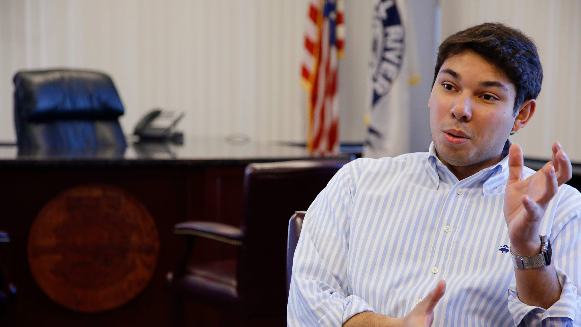 In this Wednesday, Jan. 6, 2016 photo newly elected Fall River Mayor Jasiel Correia has a conversation in his city hall office in Fall River, Mass. Correia, 24, is the youngest Fall River mayor to ever serve. (AP Photo/Stephan Savoia)