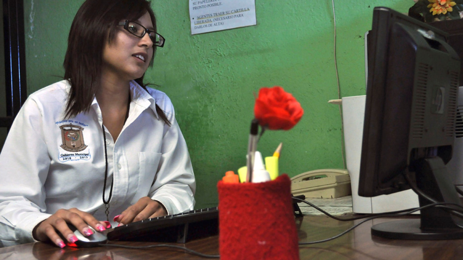 Twenty-year-old Marisol Valles Garcia sits at her desk after her swearing-in ceremony as the new police chief of the border town of Praxedis G. Guerrero, near Ciudad Juarez, Mexico, Wednesday, Oct. 20, 2010. Praxedis G. Guerrero was once a quiet farming town until two rival gangs, the Juarez and the Sinaloa drug cartels, began battling for the control of its single highway. (AP Photo/Raymundo Ruiz)