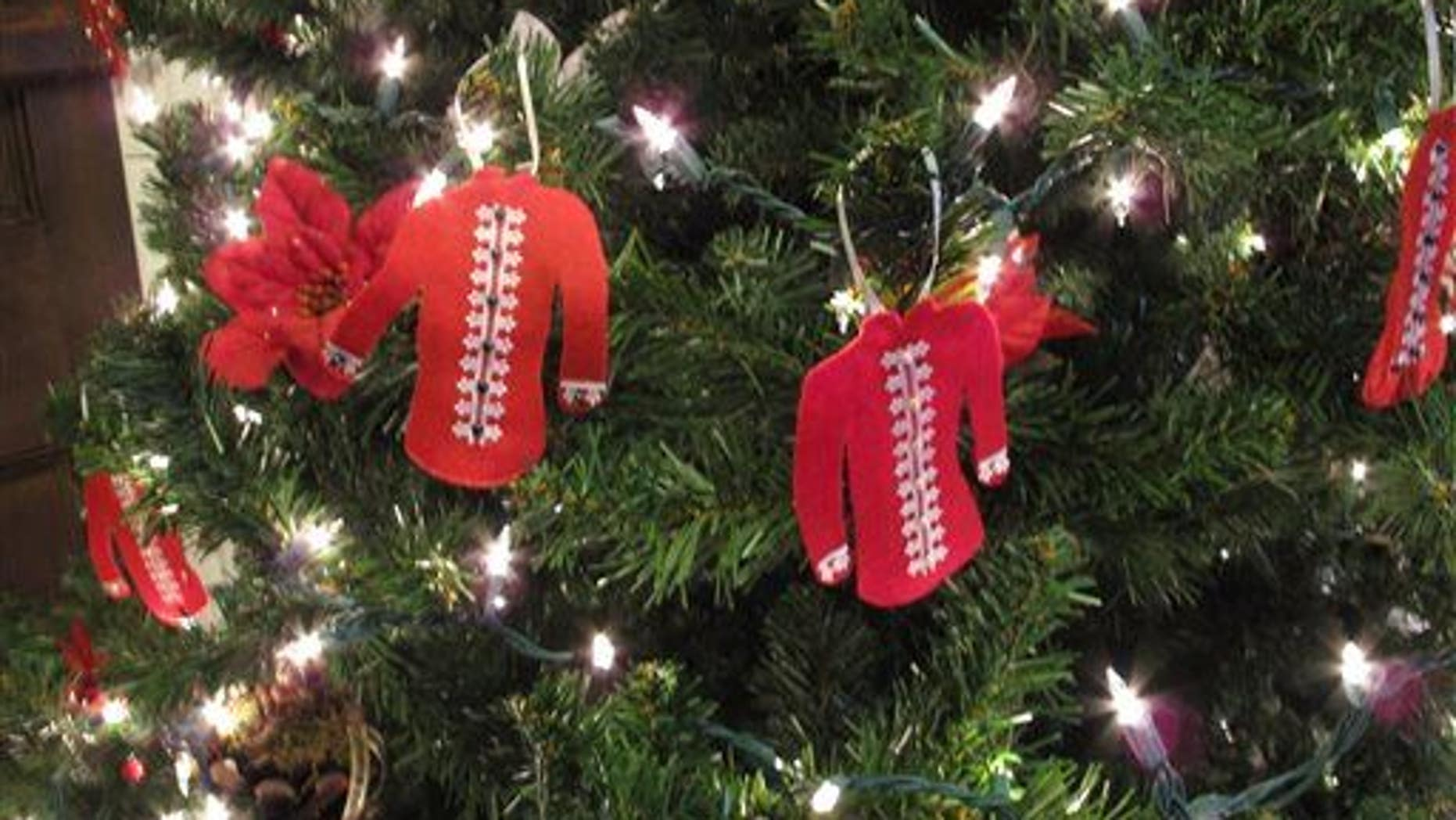 Several red shirt ornaments are on a Christmas tree at the mansion at Oakley Park on Friday, Dec. 5, 2014, in Edgefield, SC.