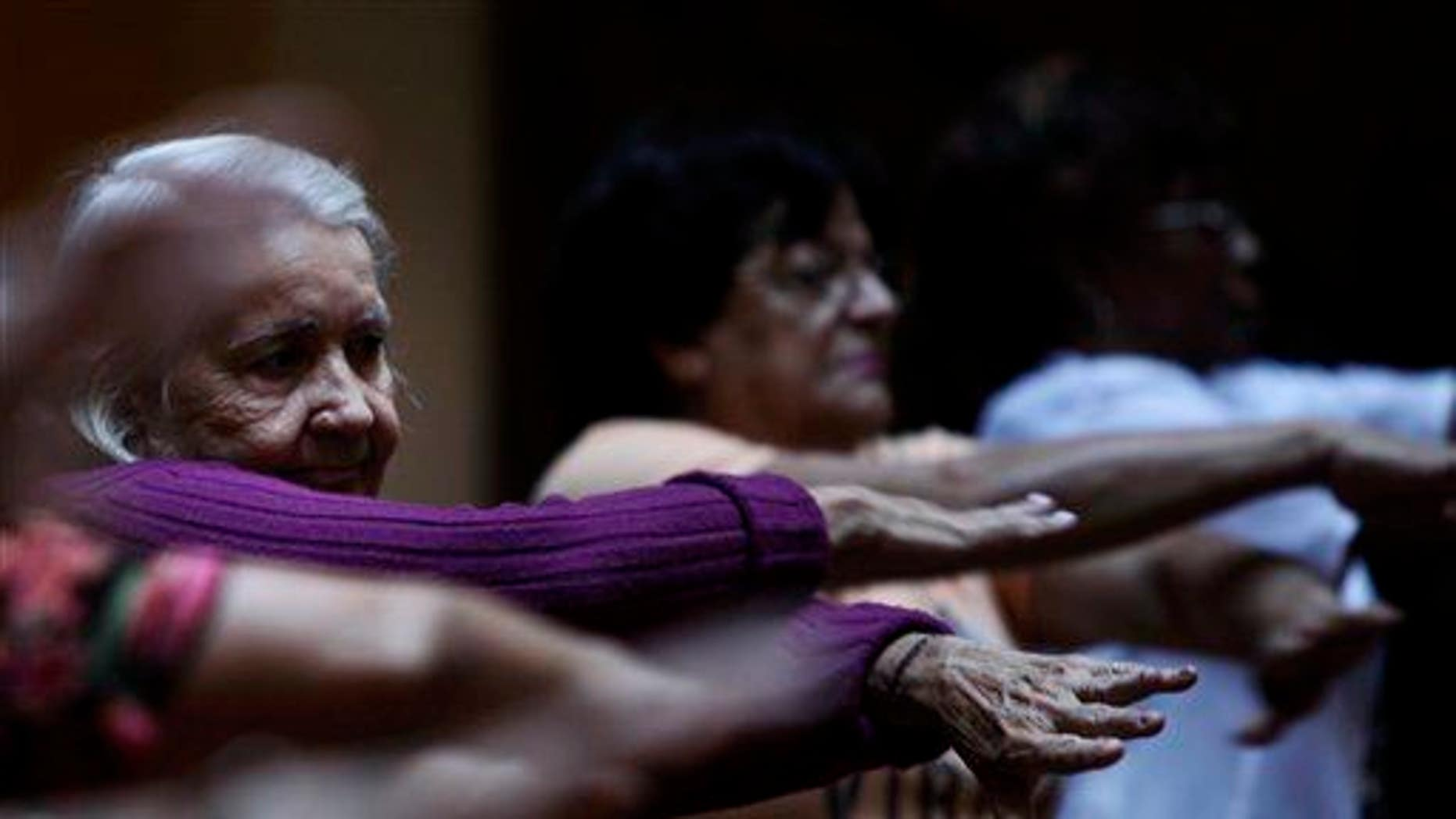 A group of senior citizens exercises.