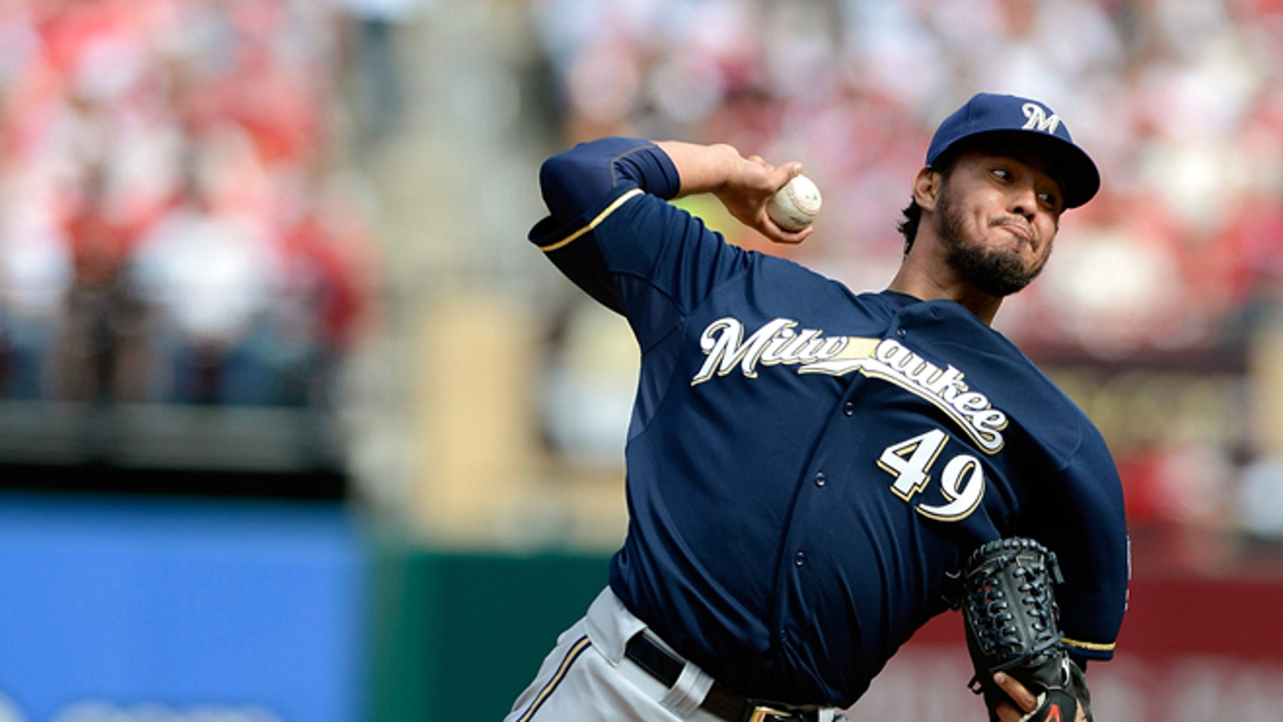 ST. LOUIS, MO - APRIL 13: Yovani Gallardo #49 of the Milwaukee Brewers throws to a St. Louis Cardinals batter during the first inning at Busch Stadium on April 13, 2013 in St. Louis, Missouri.  (Photo by Jeff Curry/Getty Images)