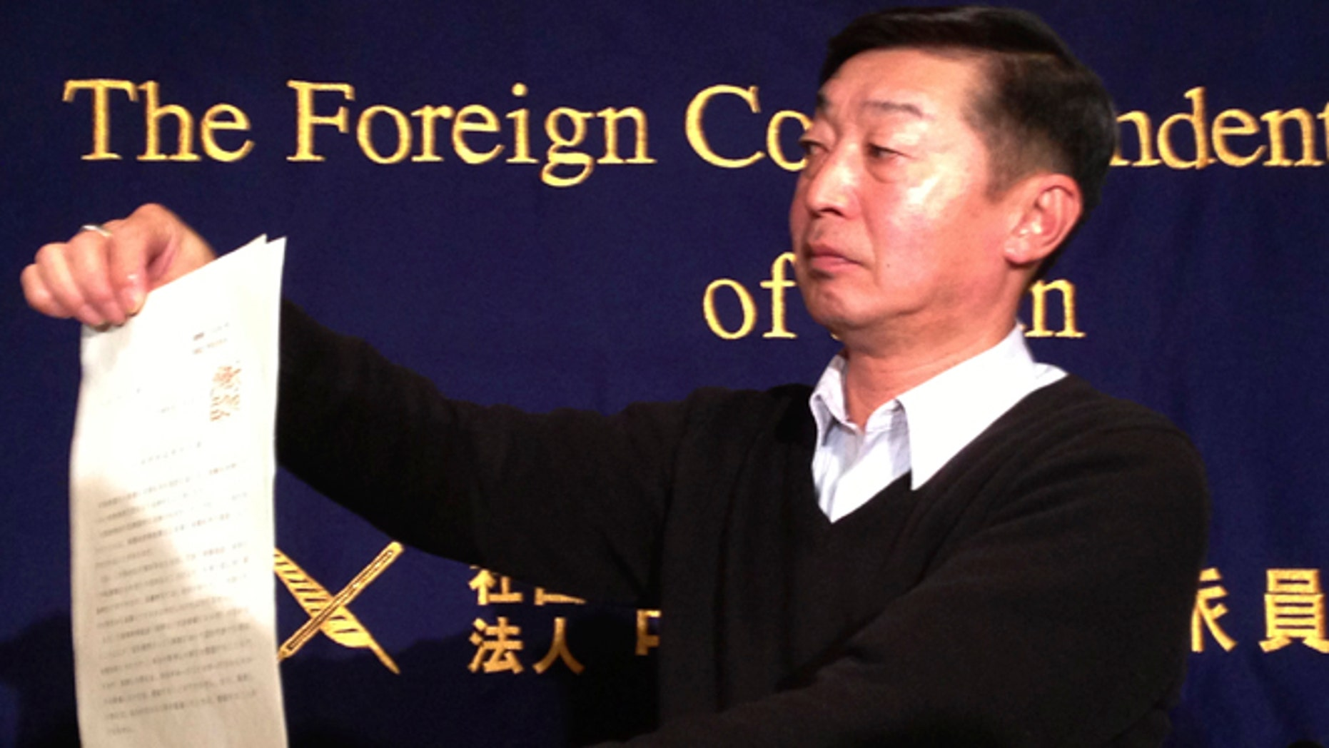 Feb. 12, 2015: Japanese freelance photographer Yuichi Sugimoto shows the press the original document of an order, signed by Foreign Minister Fumio Kishida, which he was given by Japanese foreign ministry officials at his home, during a news conference in Tokyo. Sugimoto said he was forced to give up his passport because he planned a reporting trip to Syria, which the government has stepped up warnings to its citizens not to visit after two Japanese were killed there in a recent hostage crisis.