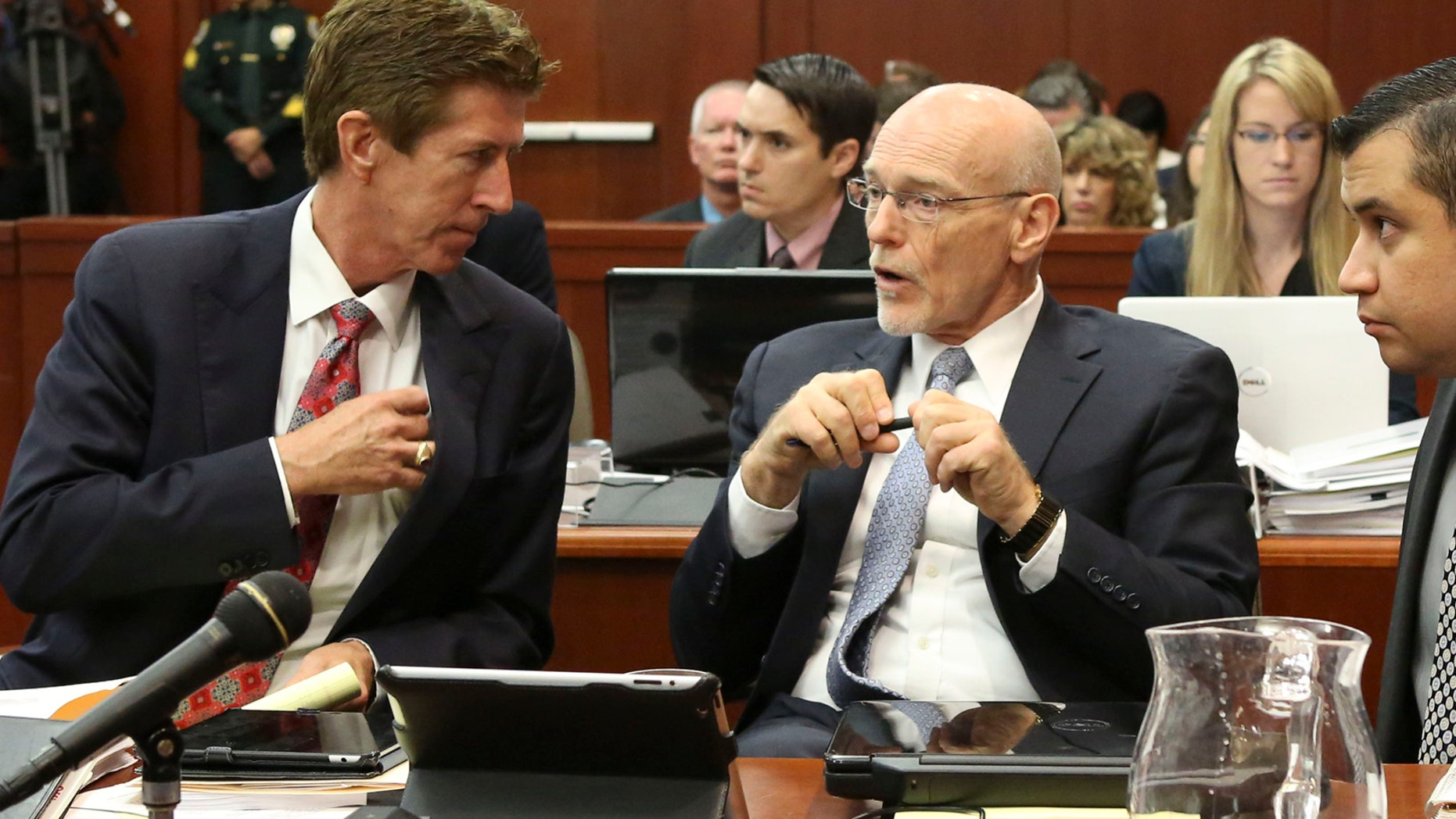 George Zimmerman listens to his defense counsel Mark O'Mara, left, and Don West, center during his trial in Sanford, Fla. July 10, 2013.