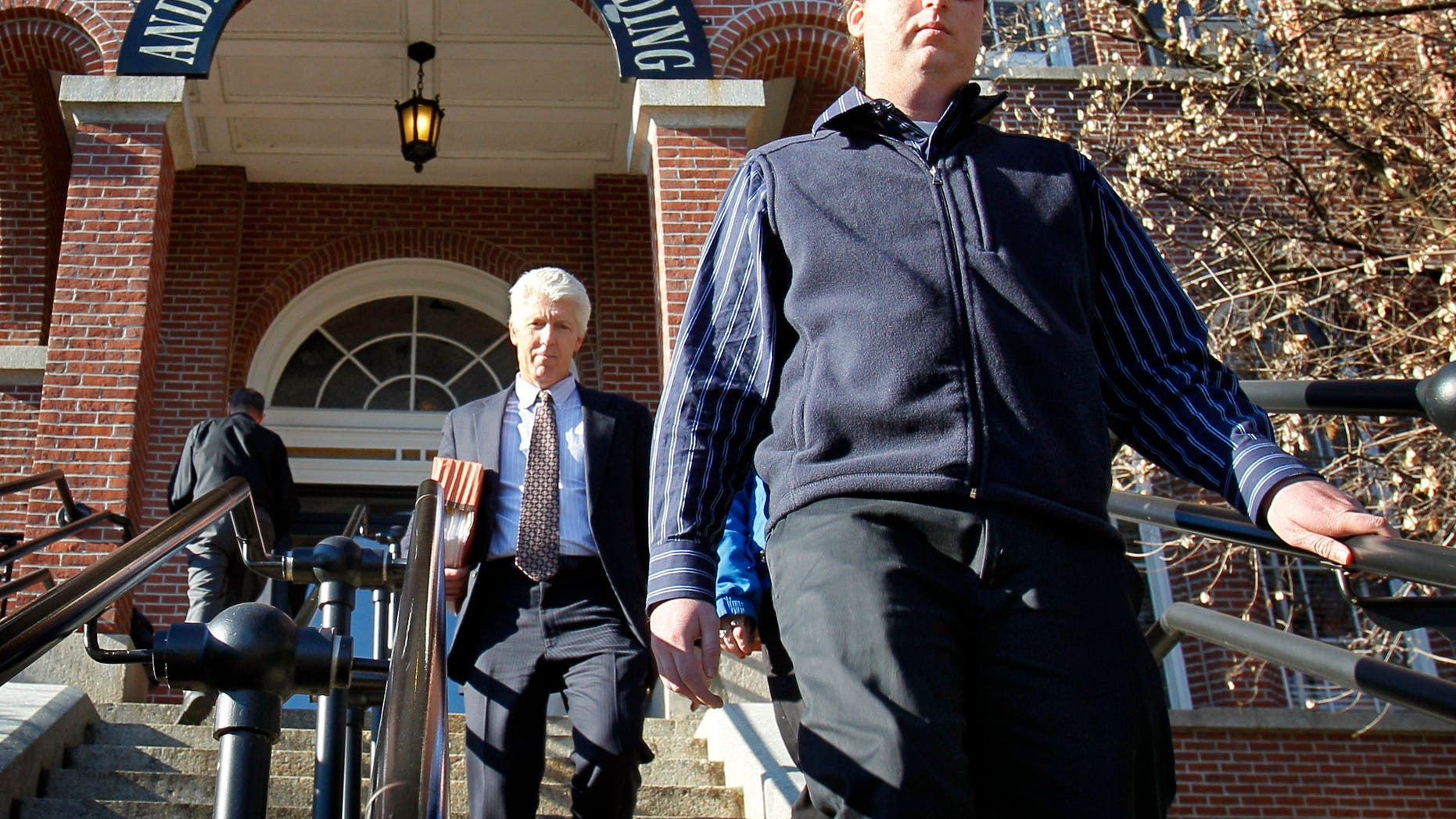 Dec. 1, 2011: Zach Tomaselli, 23, of Lewiston, Maine, right, and his lawyer, Justin Leary, leave Androscoggin Superior Court in Auburn, Maine. Tomaselli, who accused former Syracuse assistant basketball coach Bernie Fine of molesting him is seeking to suppress evidence in his own molestation case in Maine.