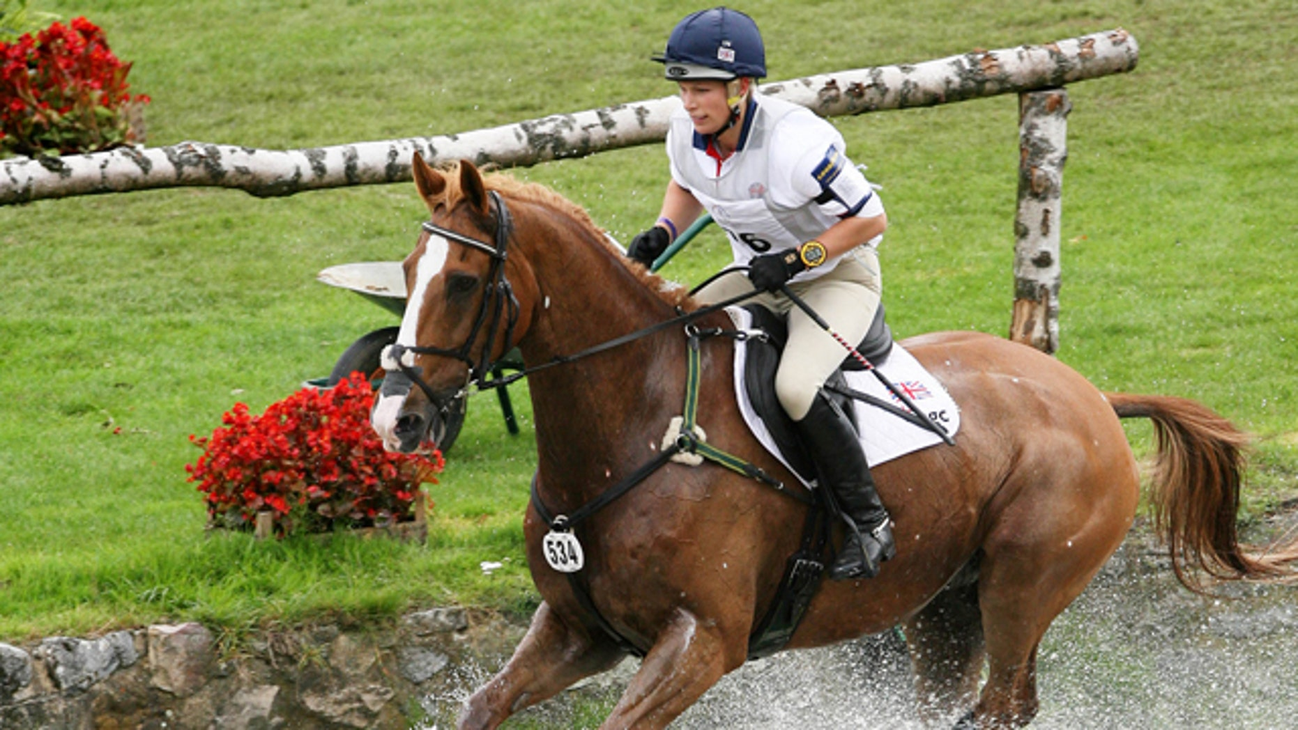 This 2007 file photo shows Britain's Zara Phillips,  granddaughter to Queen Elizabeth II,  riding 'Toytown'  in the Cross Country Test  competition of the Eventing Competitions at the World Equestrian Festival CHIO Aachen 2007 in Aachen, western Germany.