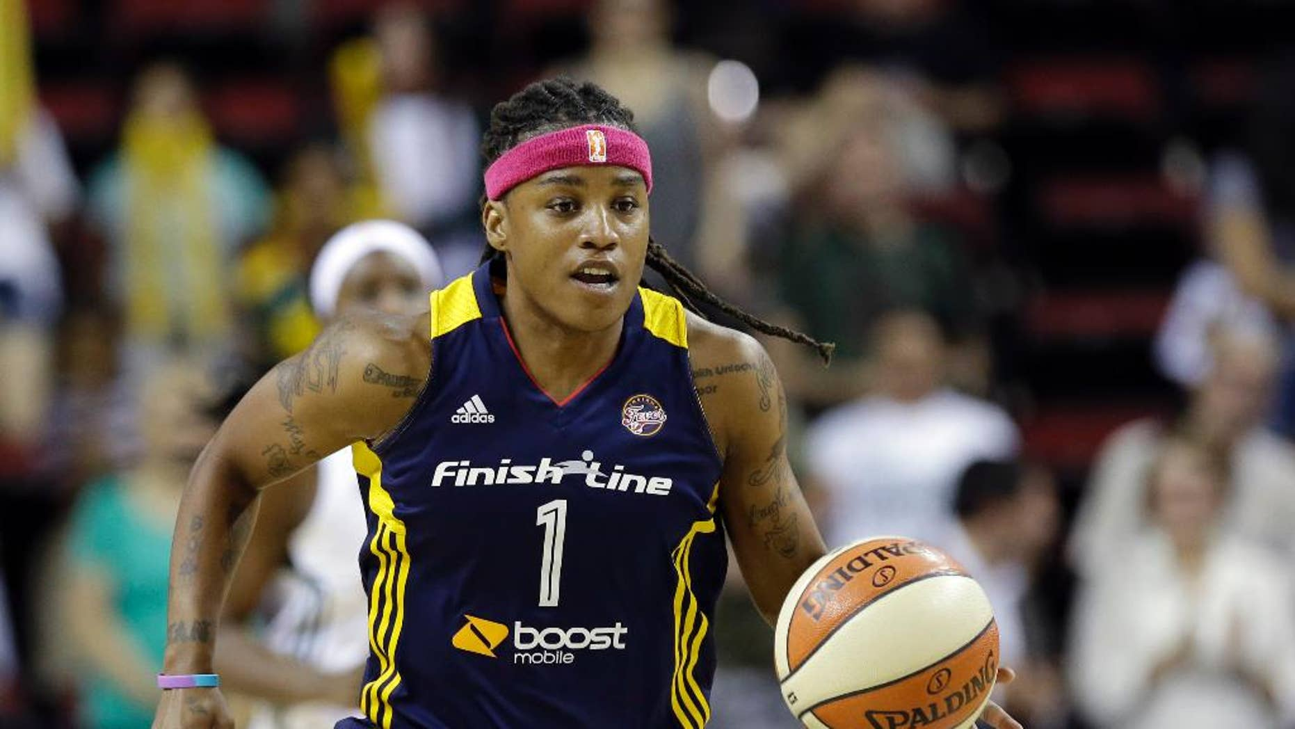 FILE - In this July 31, 2014, file photo, Indiana Fever's Shavonte Zellous moves the ball against the Seattle Storm during a WNBA basketball game in Seattle. After one of the most successful seasons in her career, leading Turkish power Galatasary to championships in both the domestic league and Euroleague, Zellous is now embroiled in a salary dispute. The club's former president promised Zellous and her teammates that their bonuses would be doubled after Galatasary beat rival Fenerbahce. They're still waiting for their money.(AP Photo/Elaine Thompson, File)