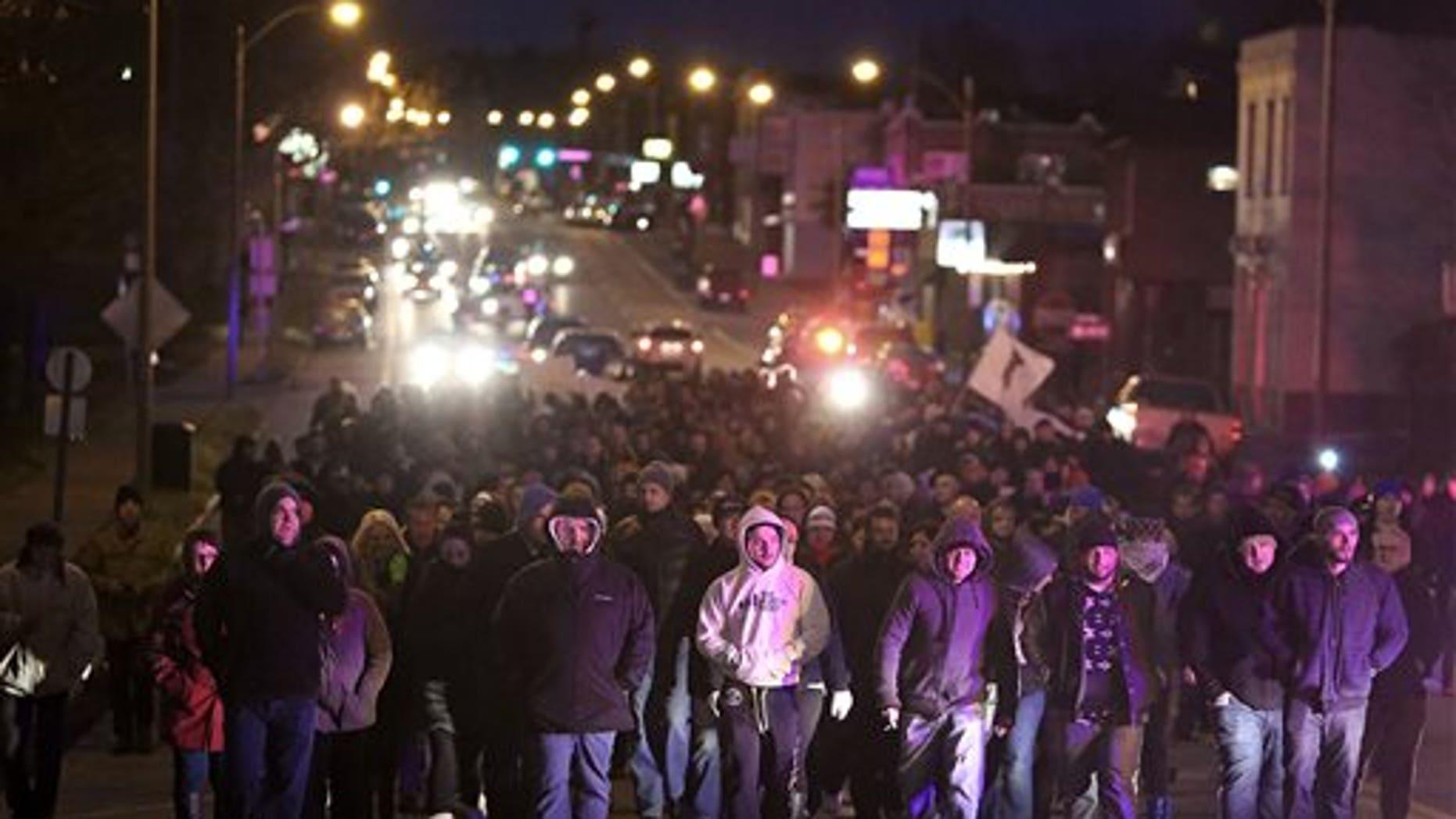 Dec. 1: Bosnians march along Gravois Road to protest the murder of Zemir Begic, a Bosnian man, in St. Louis.