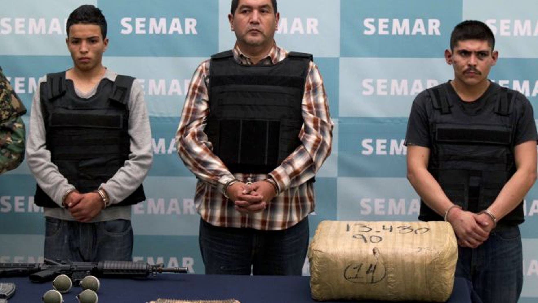 "Zetas drug cartel leader Iván ""El Taliban"" Velázquez Caballero (center). AP file photo."