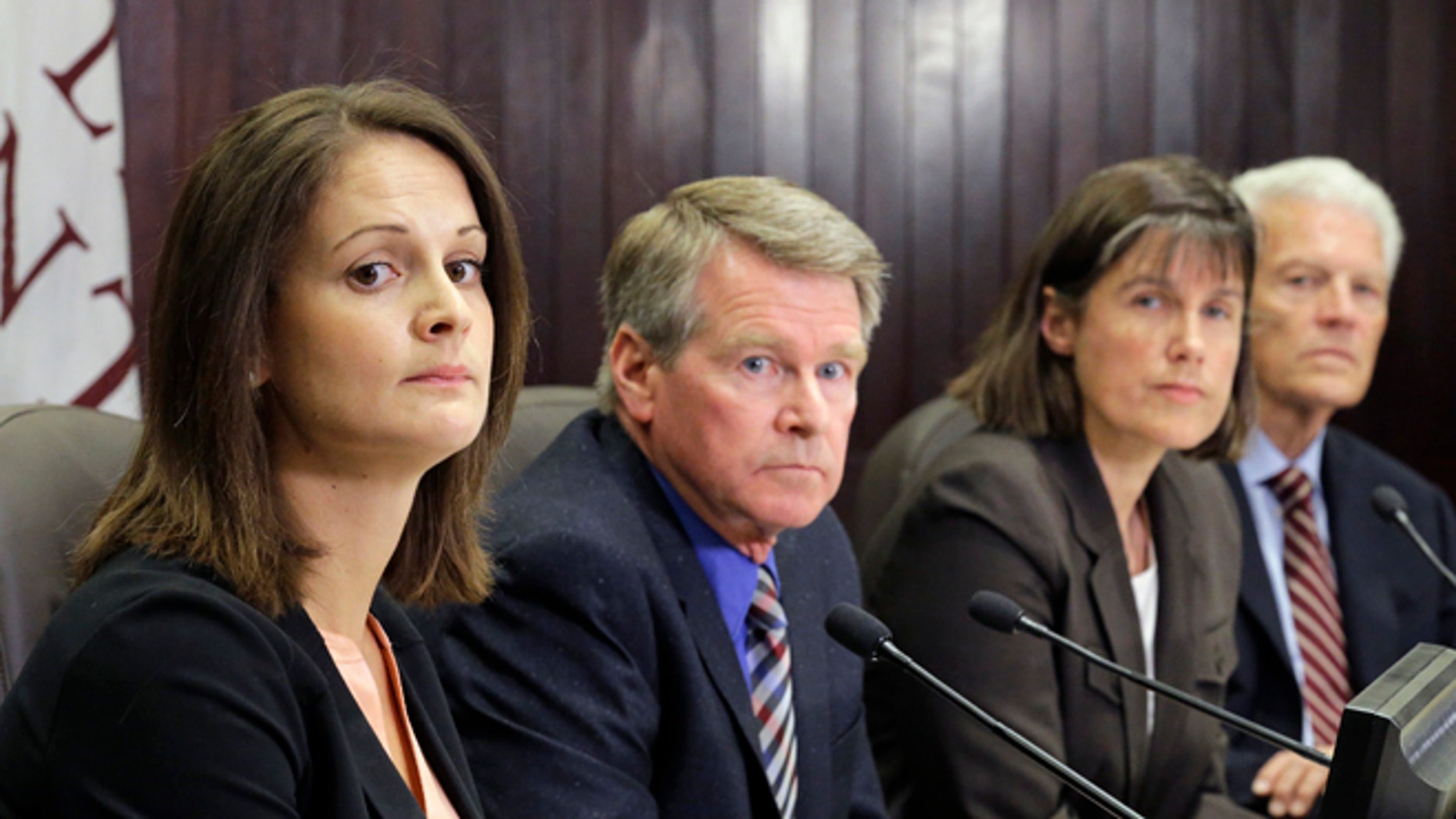 Left to right, Dr. Angela Dunn, deputy state epidemiologist at the Utah Department of Health; Gary Edwards, executive director, Salt Lake County Health Department; Dr. J. Erin Staples, Medical Epidemiologist, Centers for Disease Control and Prevention,and Dr. Edward Clark Associate Vice President Clinical Affairs University of Utah speak during a news conference Monday, July 18, 2016, in Salt Lake City. A person who cared for a Zika-infected relative in Utah also got the virus, but exactly how it was transmitted is a medical mystery, health officials announced Monday. (AP Photo/Rick Bowmer)