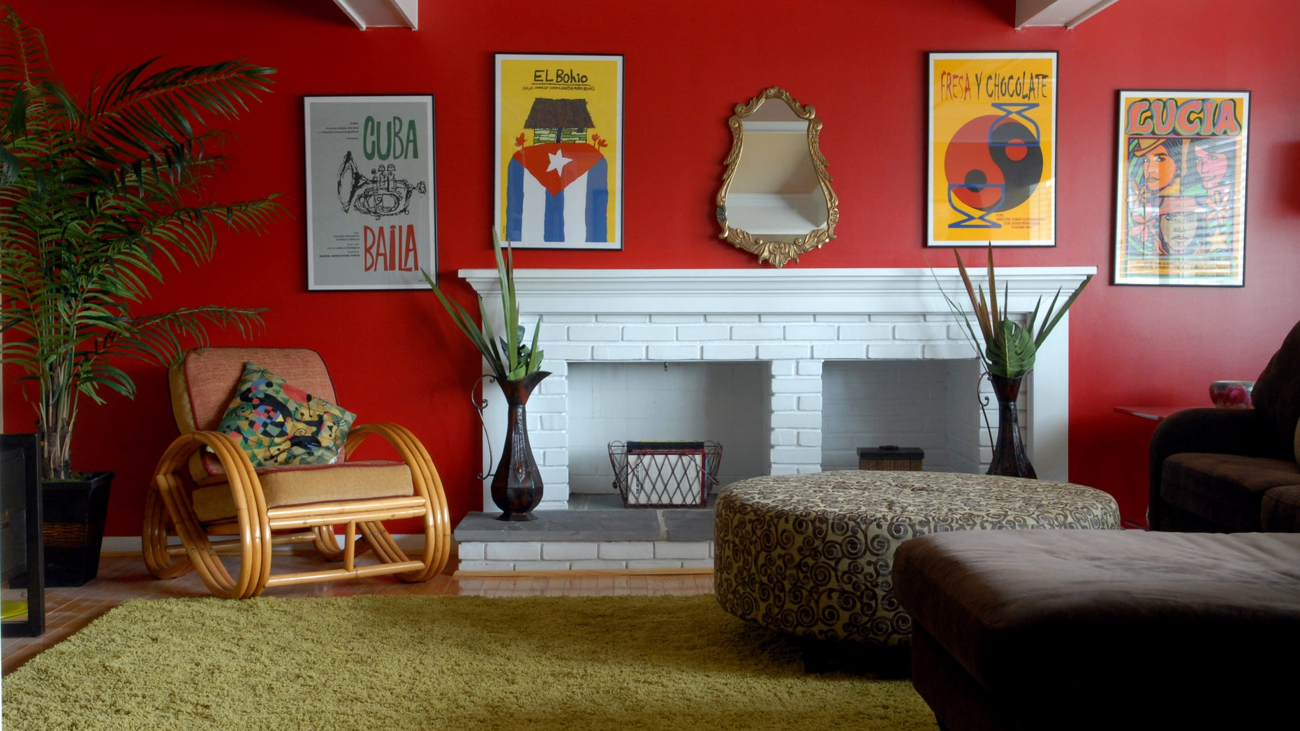 The red walls in this home were inspired by the homeowner's art from Cuba.