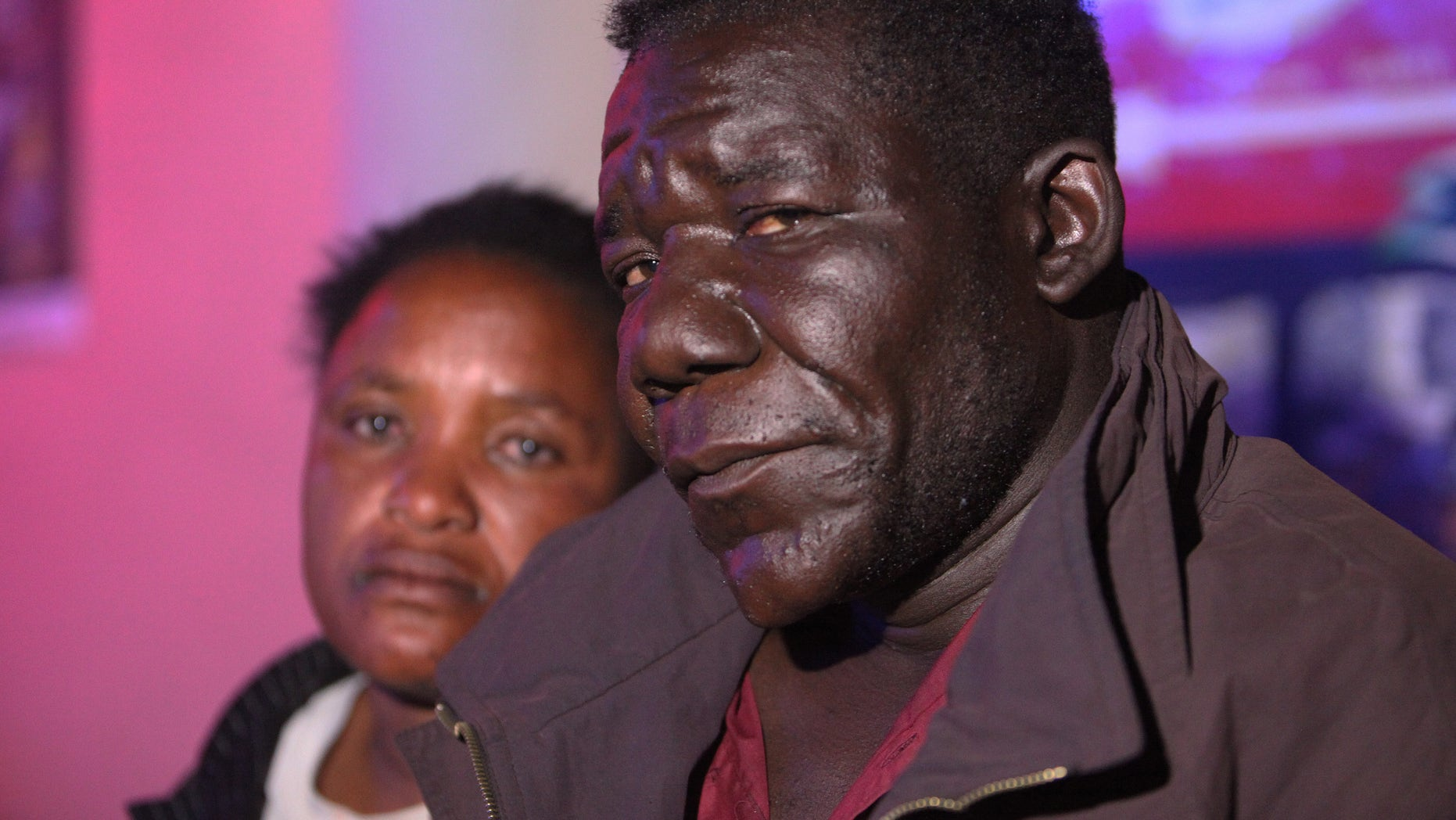 William Masvinhu, right, winner of  the Mr Ugly competition poses for a photo with his wife Alice at a local club in Harare, Tuesday, May, 29, 2012. The competition which is in its second year was won by William Masvinhu who walked away with US$100 in cash and one night accommodation voucher at a 3 star hotel while  Freddy Mwanda came second walking away with US$50.  (AP Photo/Tsvangirayi Mukwazhi)