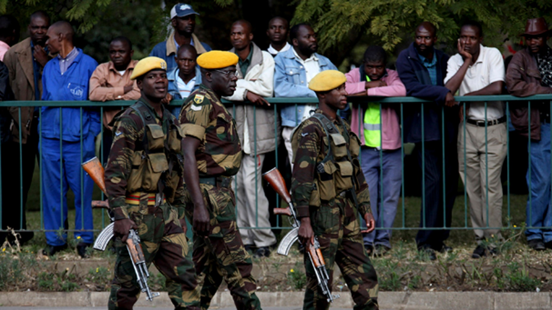 July 14: Members of the Zimbabwe National Army take up positions following the arrival of President Robert Mugabe, for the presentation of the mid term monetary review in Harare. (AP)