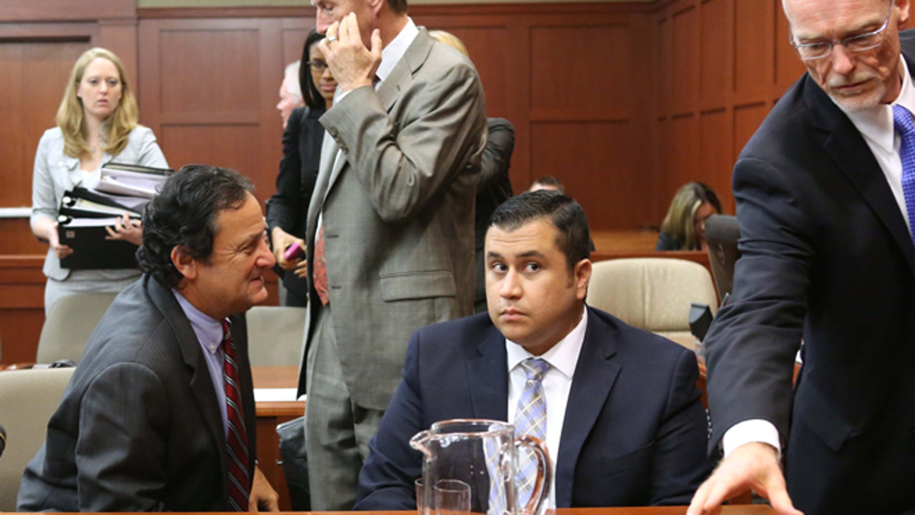 Defense attorney Mark O'Mara, second from left, jury consultant Robert Hirschhorn, left, George Zimmerman and co-counsel Don West, right, chat during a recess in Seminole circuit court during Zimmerman's trial, in Sanford, Fla., Tuesday, June 11, 2013. Zimmerman has been charged with second-degree murder for the 2012 shooting death of Trayvon Martin.(AP Photo/Orlando Sentinel, Joe Burbank, Pool)