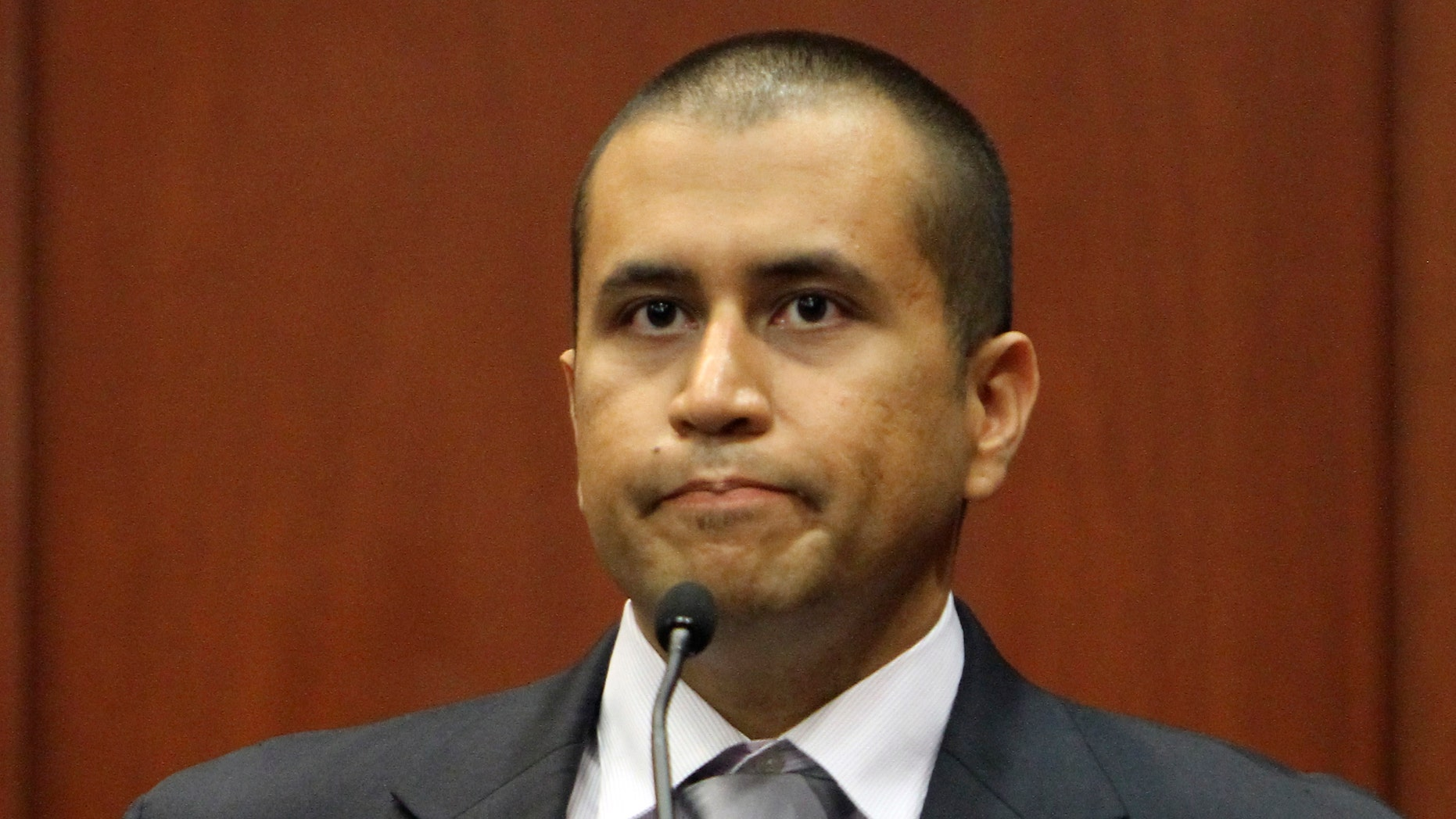 George Zimmerman appears before Circuit Judge Kenneth R. Lester Jr. Friday, April 20, 2012, during a bond hearing in Sanford, Fla. Lester says Zimmerman can be released on $150,000 bail as he awaits trial for the shooting death of Trayvon Martin. Zimmerman is charged with second-degree murder in the shooting of Martin. He claims self-defense.  (AP Photo/Orlando Sentinel, Gary W. Green, Pool)