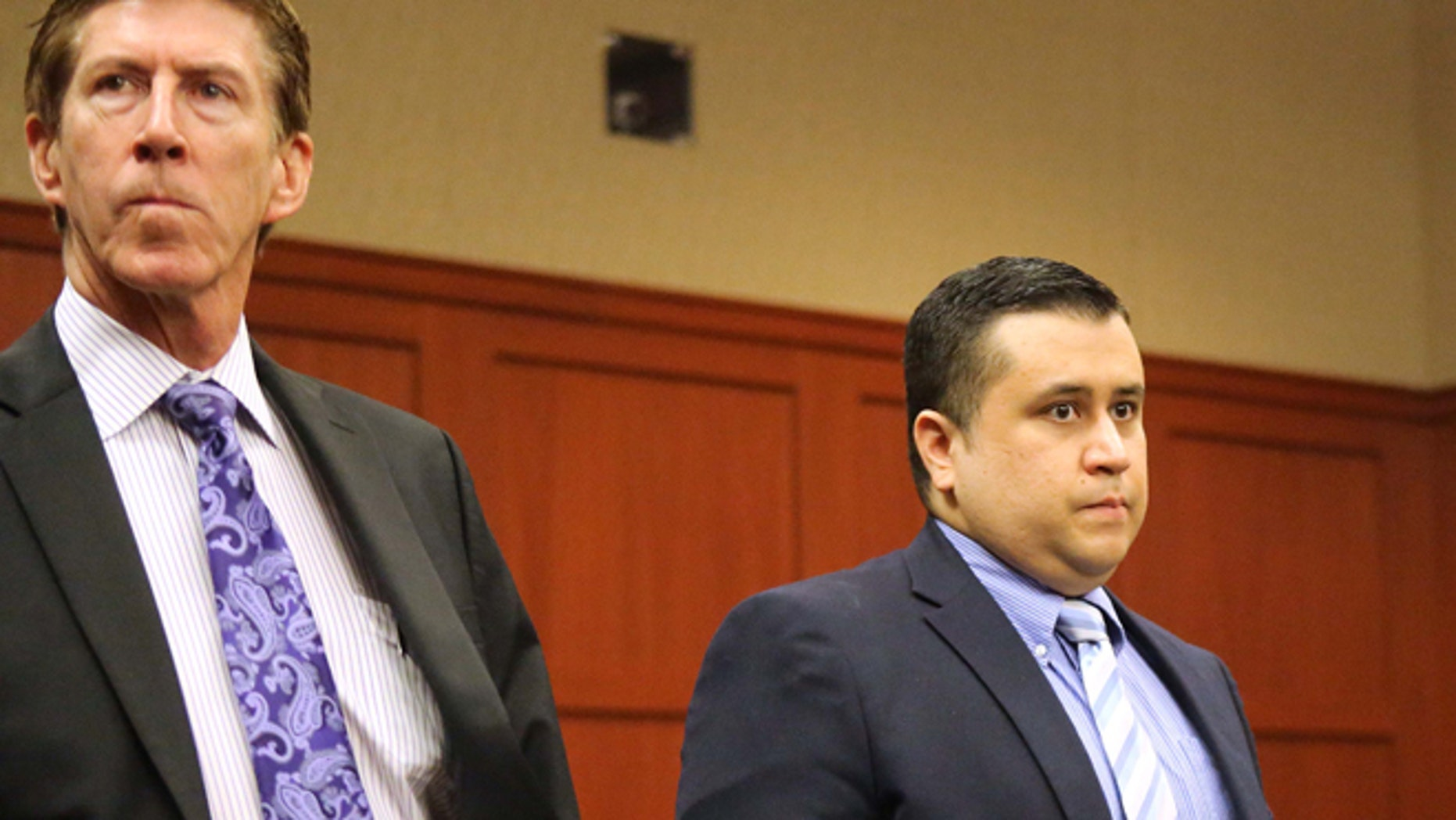 Feb. 5: George Zimmerman, right, wears a bulletproof vest in public, Mark O'Mara, left, his attorney, says.