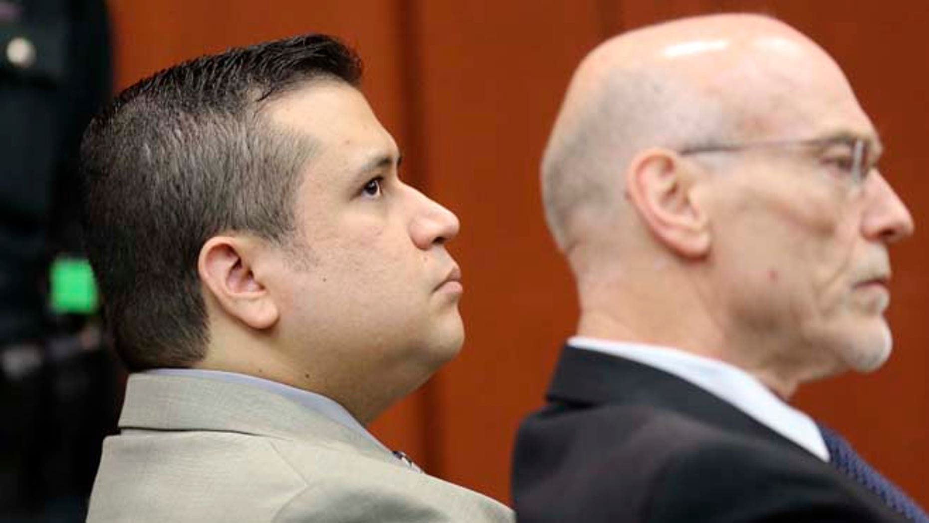 June 6, 2013: George Zimmerman, left, sits in Seminole circuit court with co-counsel Don West, during a pre-trial hearing, in Sanford, Fla. (AP/Pool/Orlando Sentinel)