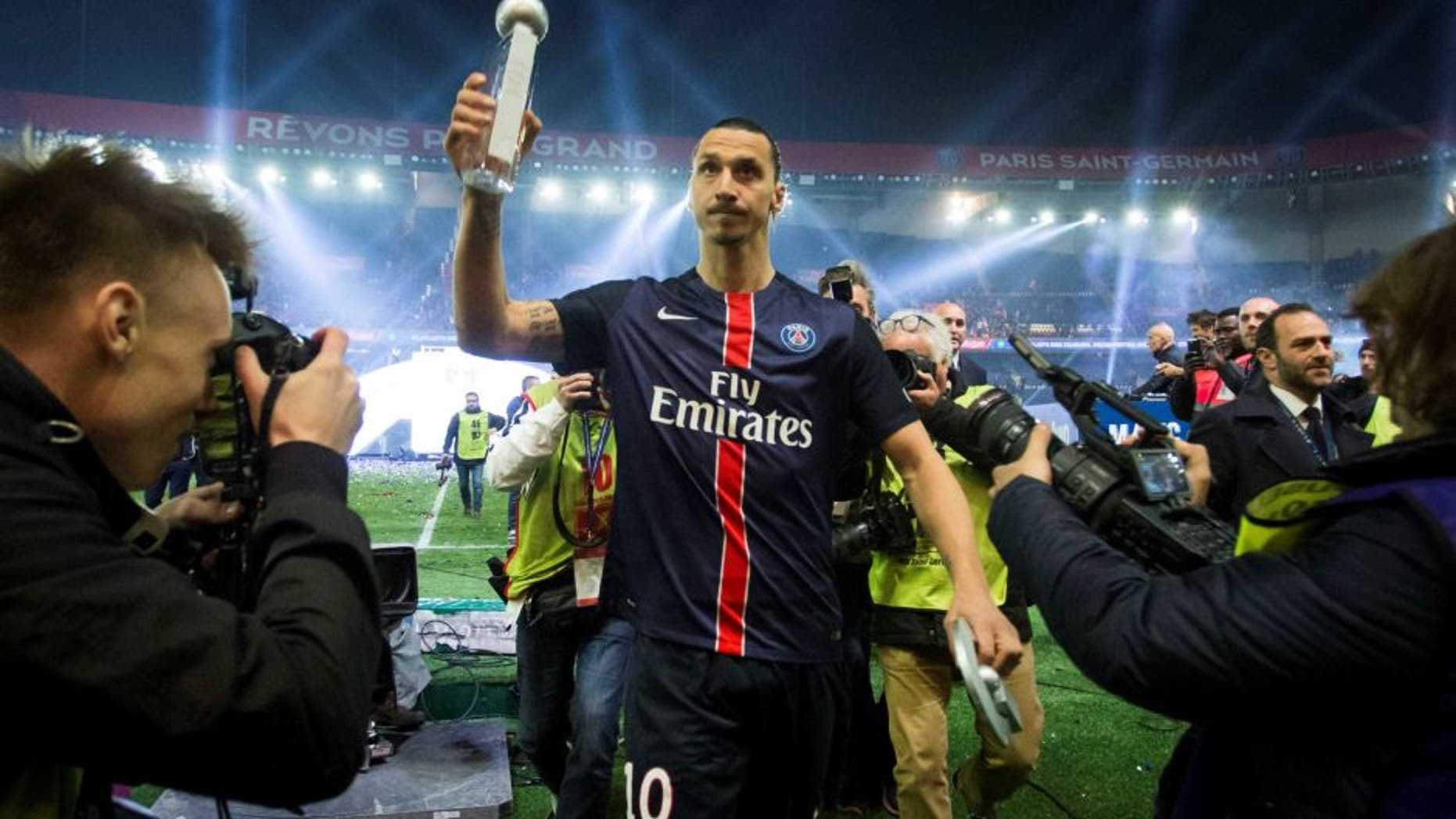PARIS, FRANCE - MAY 14: Paris Saint-Germain's Swedish forward Zlatan Ibrahimovic holds the trophy after winning the French L1 title at the end of the French L1 football match between Paris Saint-Germain (PSG) vs Nantes on May 14, 2016 at the Parc des Princes stadium in Paris, France. (Photo by Geoffroy Van der Hasselt/Anadolu Agency/Getty Images)