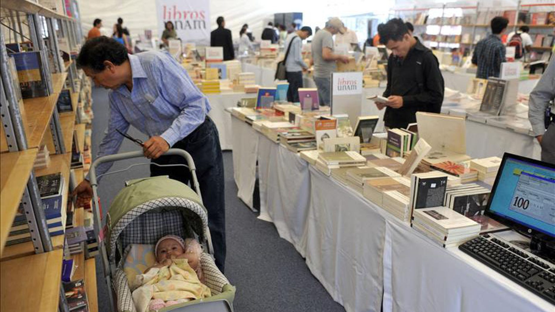 Visitors browse the offerings on Oct. 19 at the 12th Zocalo International Book Fair in Mexico City.