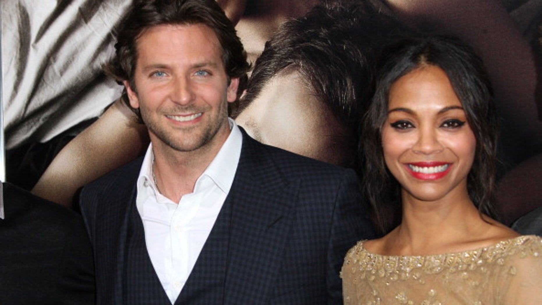 """Actor Bradley Cooper (L) and actress Zoe Saldana attend the premiere of """"The Words"""" at the ArcLight Cinemas in Hollywood, California."""