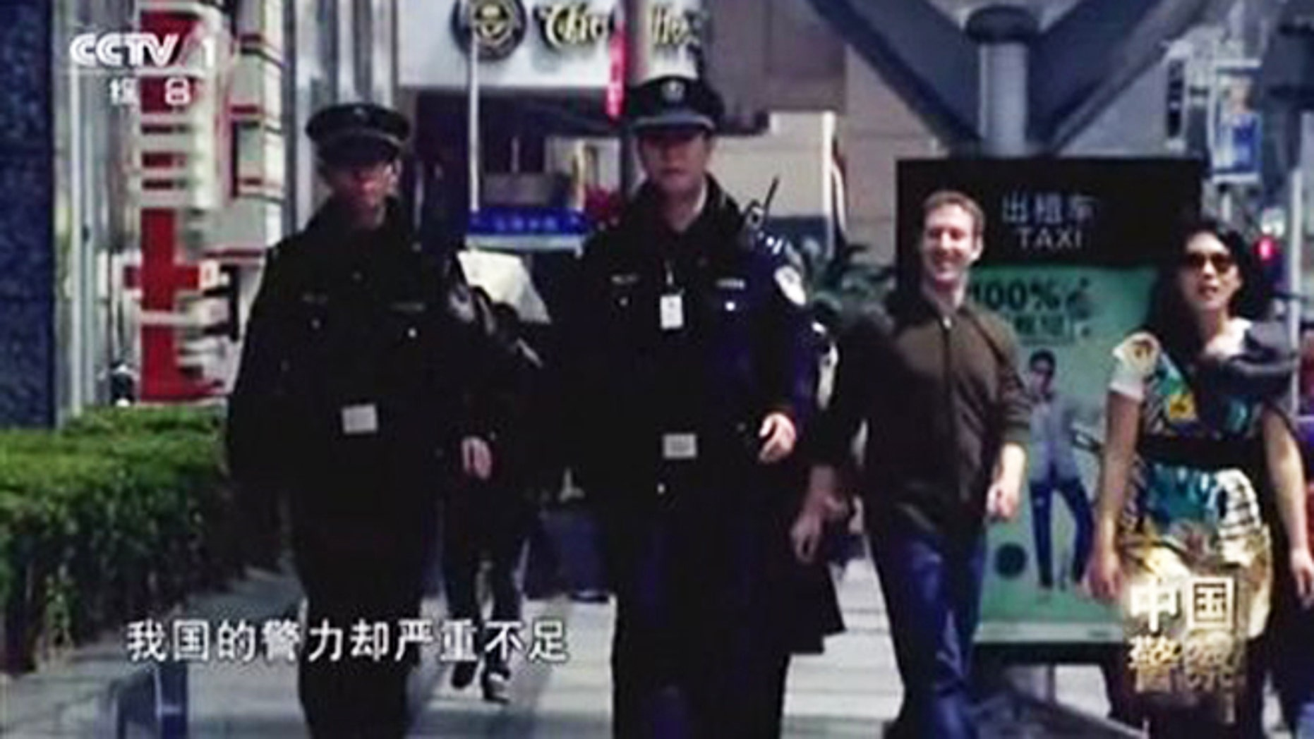 In this image taken from undated CCTV video, Facebook founder Mark Zuckerberg and his now-wife, Priscilla Chan, appear in a Chinese TV documentary about the countrys police force. The footage shows the couple wearing the same clothes they were photographed in during a March 27, 2012 visit to Shanghai.