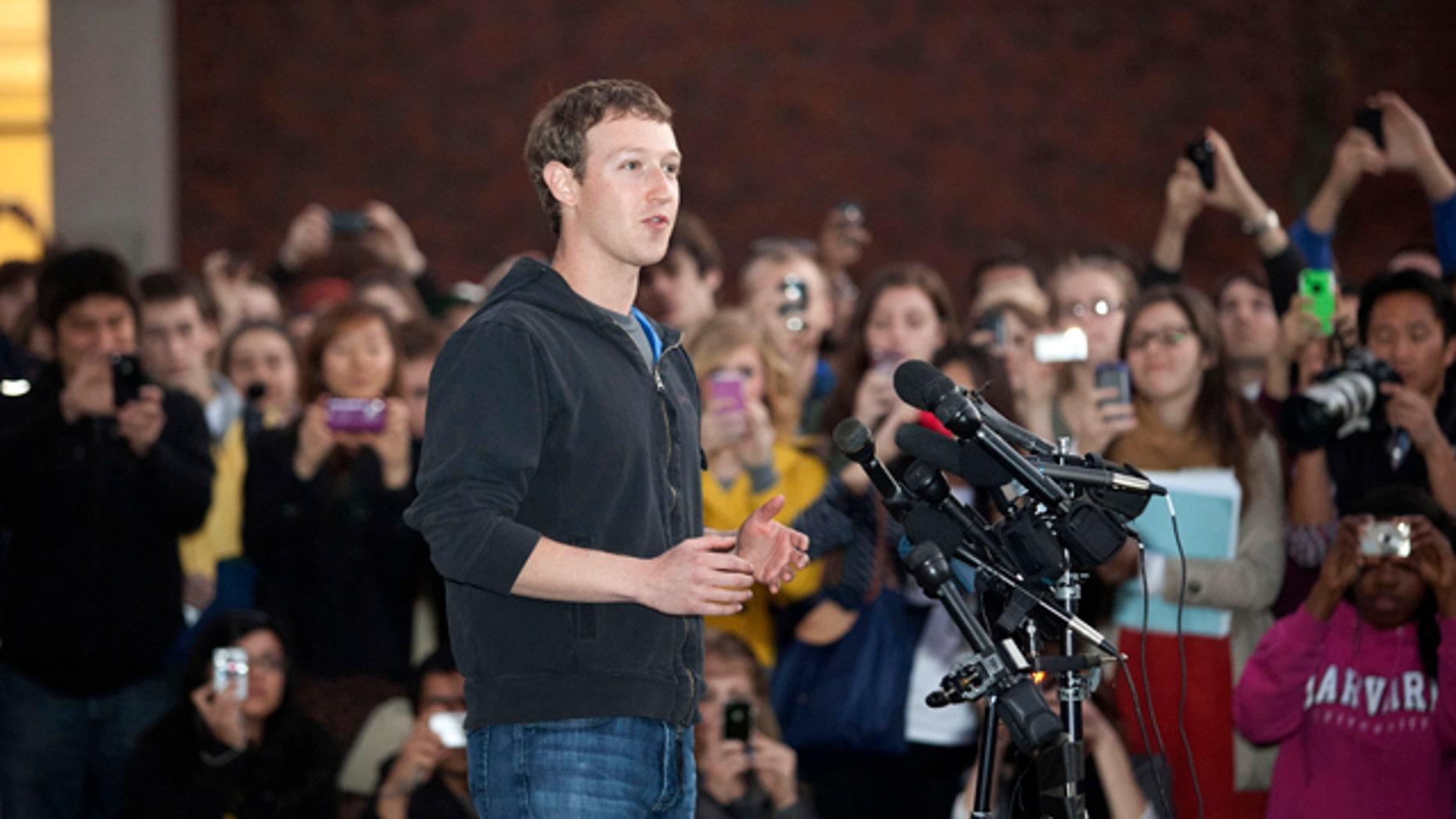 Nov. 7, 2011: Facebook creator Mark Zuckerberg speaks to students outside Lamont Library on the campus of Harvard University, in Cambridge, Mass.
